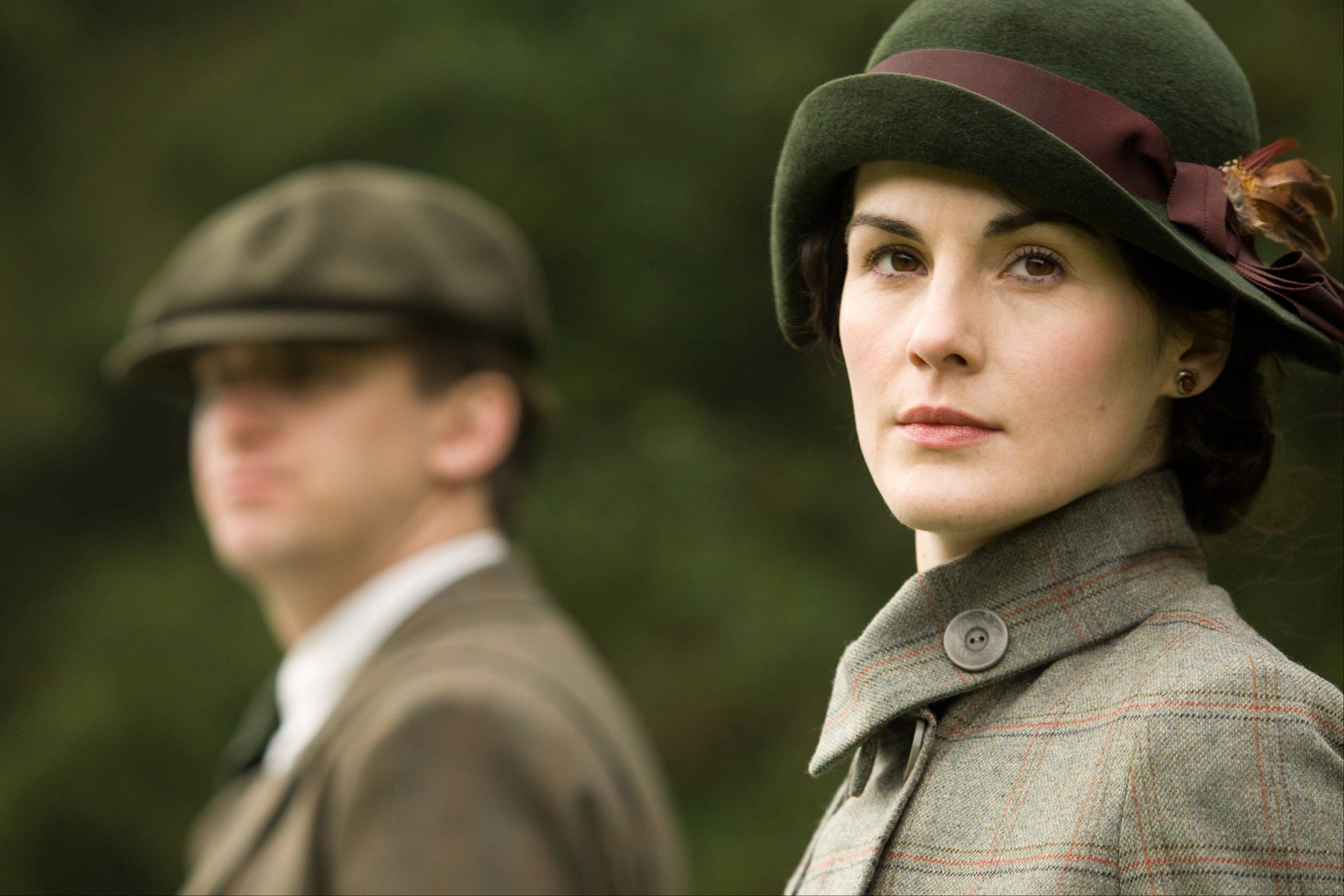"Dan Stevens as Matthew Crawley, left, and Michelle Dockery as Lady Mary from the second season on ""Downton Abbey."" The program was nominated for an Emmy award for outstanding drama series."