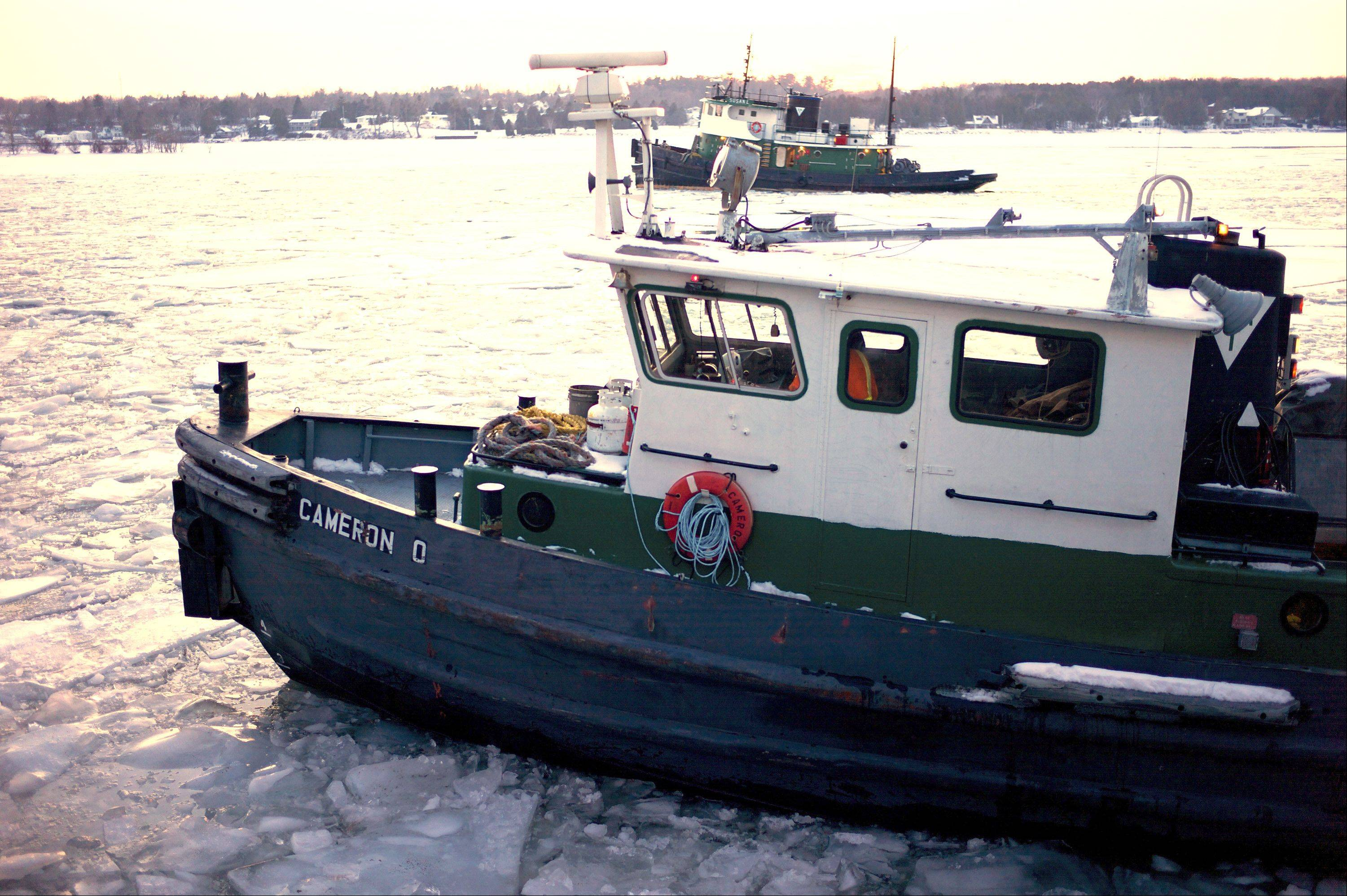 "A tugboat called the ""Jimmy L."" embarks on an ice-breaking mission across Green Bay, Wis. The tugboat belongs to Selvick Marine Towing in Sturgeon Bay, Wis., and will be featured on ""Great Lake Warriors,"" an eight-part, History Channel reality series that follows tugboat captains and their crews across the Great Lakes."
