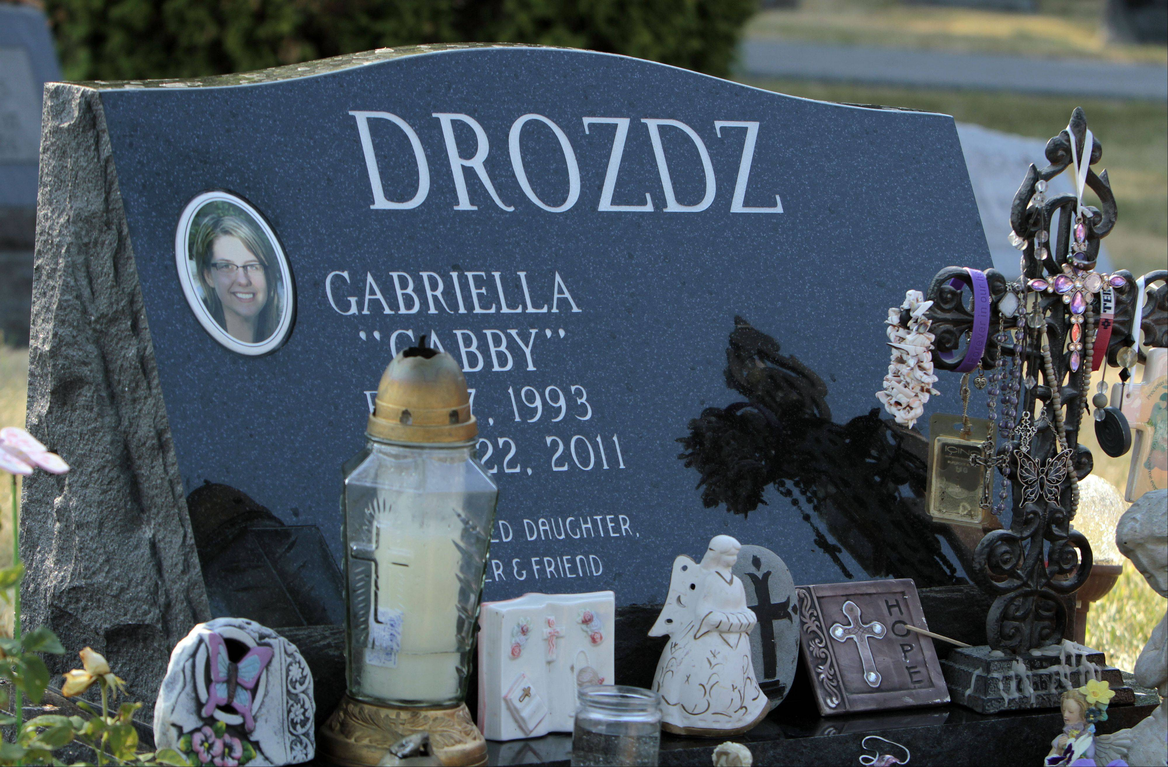 Gabriella Drozdz's grave in Lake Zurich is decorated with trinkets left by friends and family. Gabriella died a year ago when she and two friends were struck by a hit-and-run driver struck while walking along Church Street in Lake Zurich.