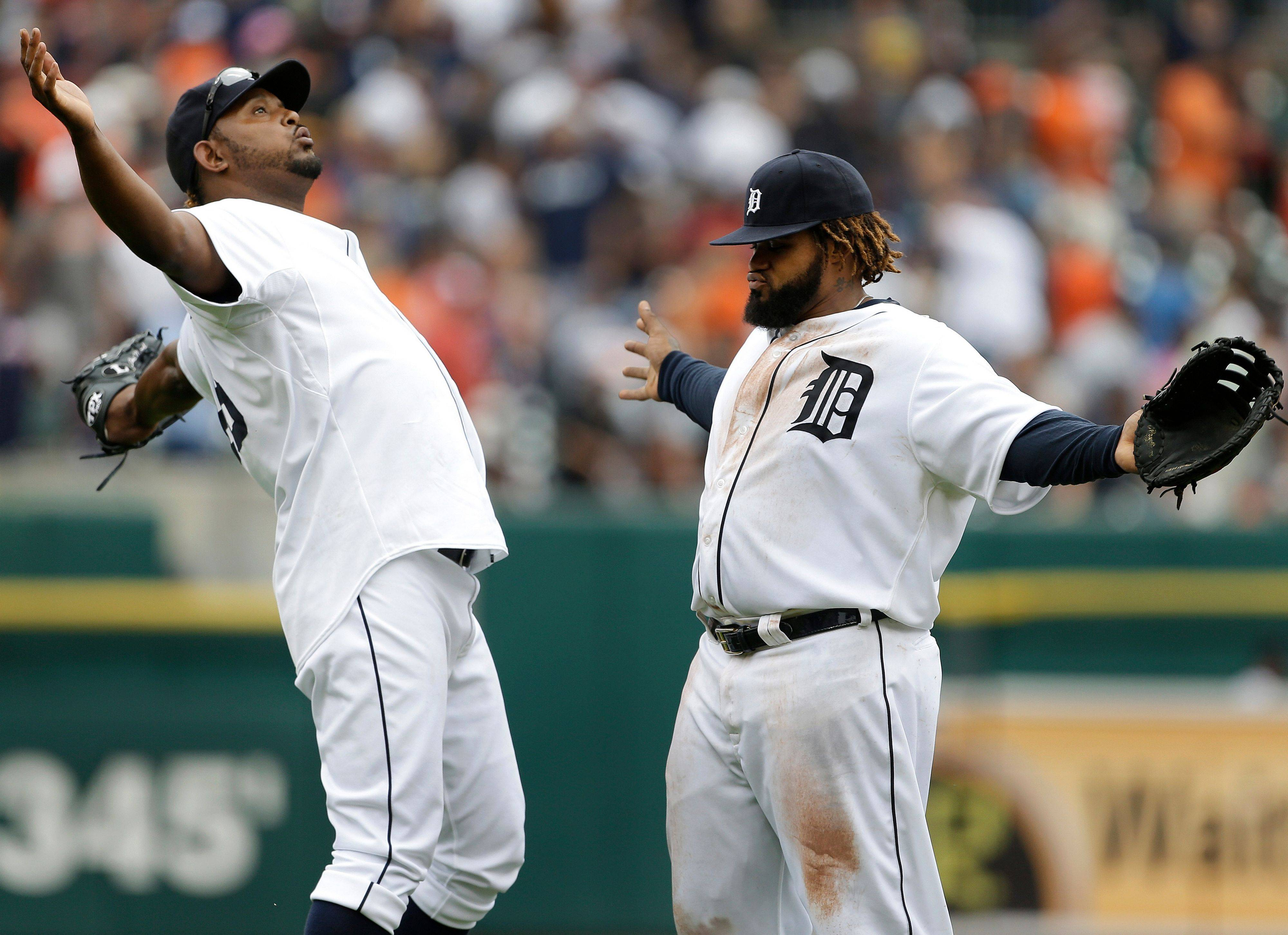 Detroit's Jose Valverde, left, and Prince Fielder celebrate their 5-2 win over the Angels on Thursday. The Tigers have won 10 of their last 12 and are just 1� games behind the White Sox in the AL Central.