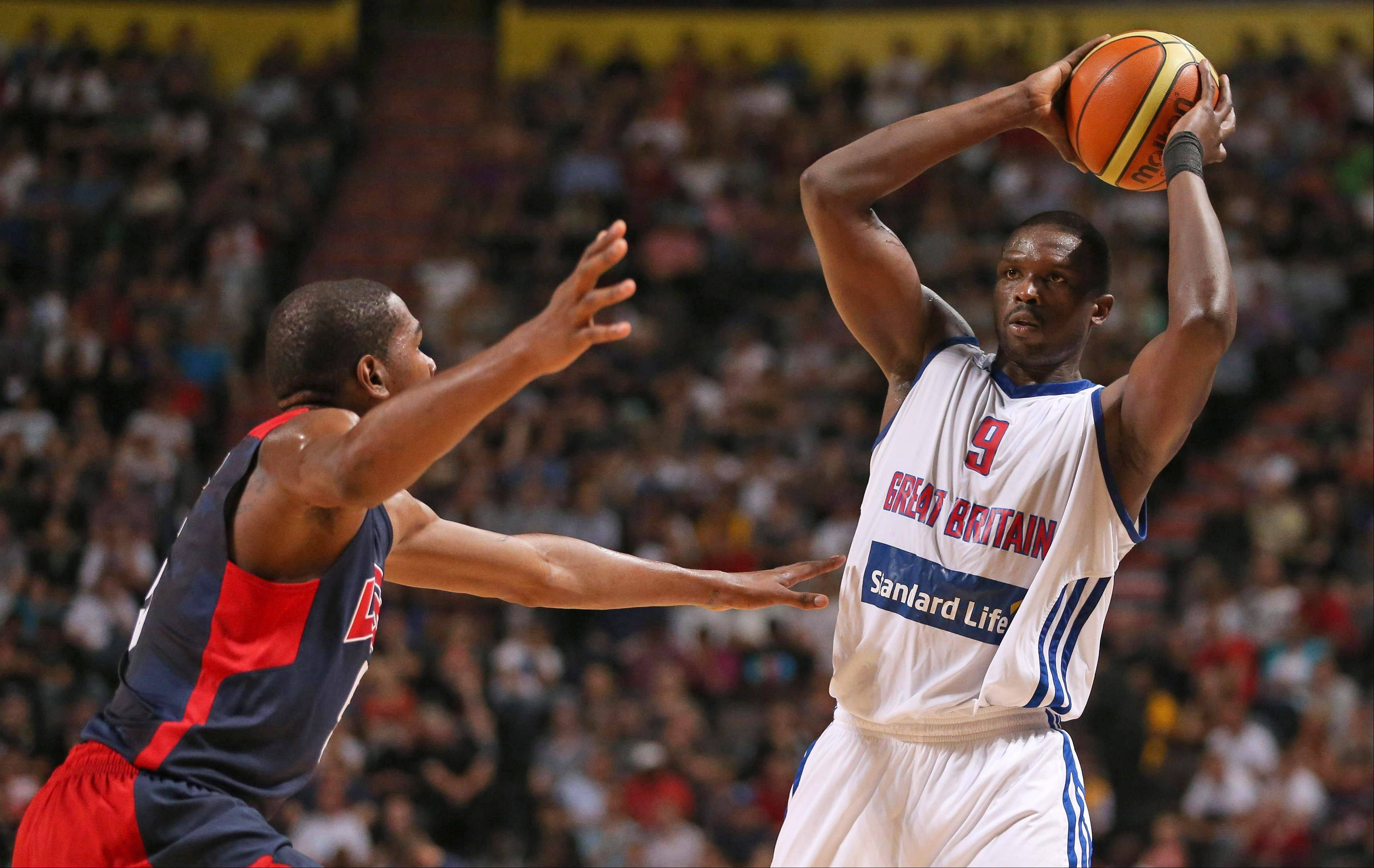 The Great Britain's Luol Deng, right, looks for a pass under pressure from USA's Kevin Durant Thursday against the USA at the Manchester Arena,