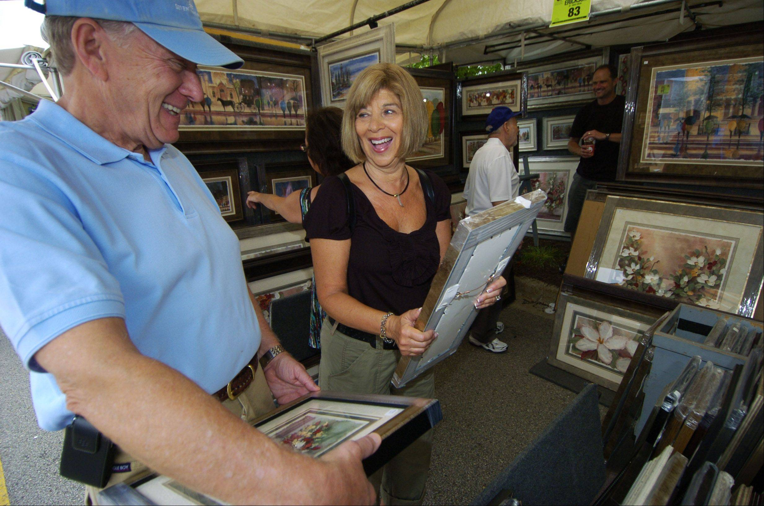 Herb and Bonnie Horn of Glenview view prints during the 2011 Buffalo Grove festival.