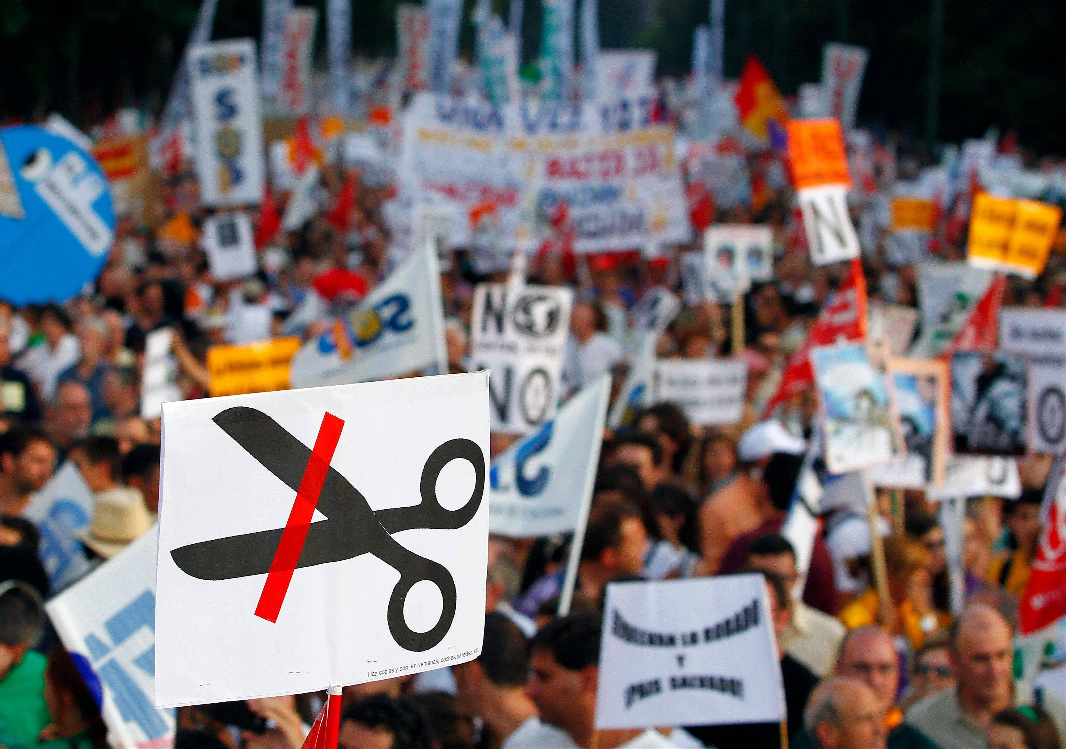 Demonstrators protest against austerity measures announced by the Spanish government in Madrid, Spain.