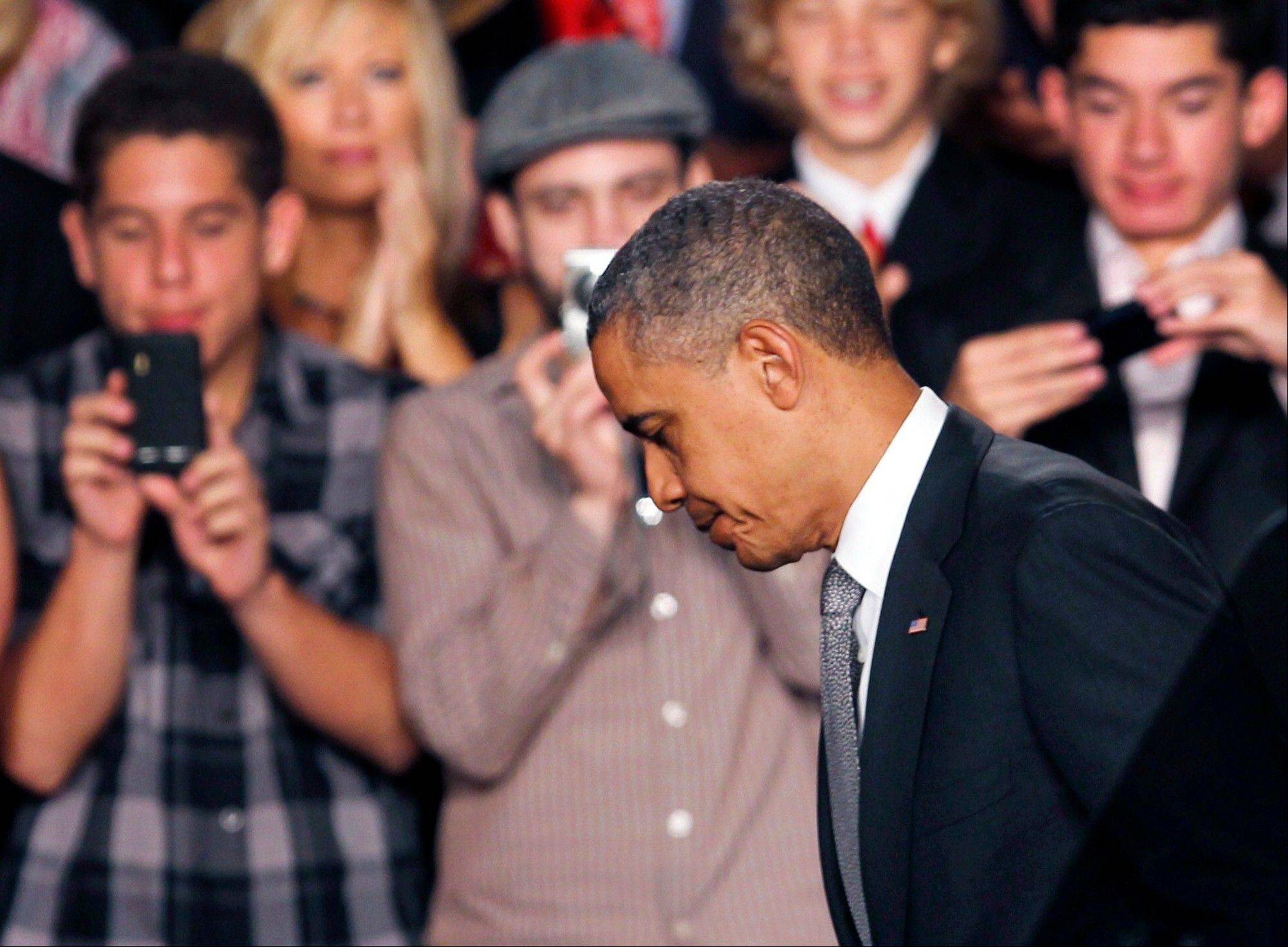 Obama calls for reflection after 'senseless' Colorado massacre