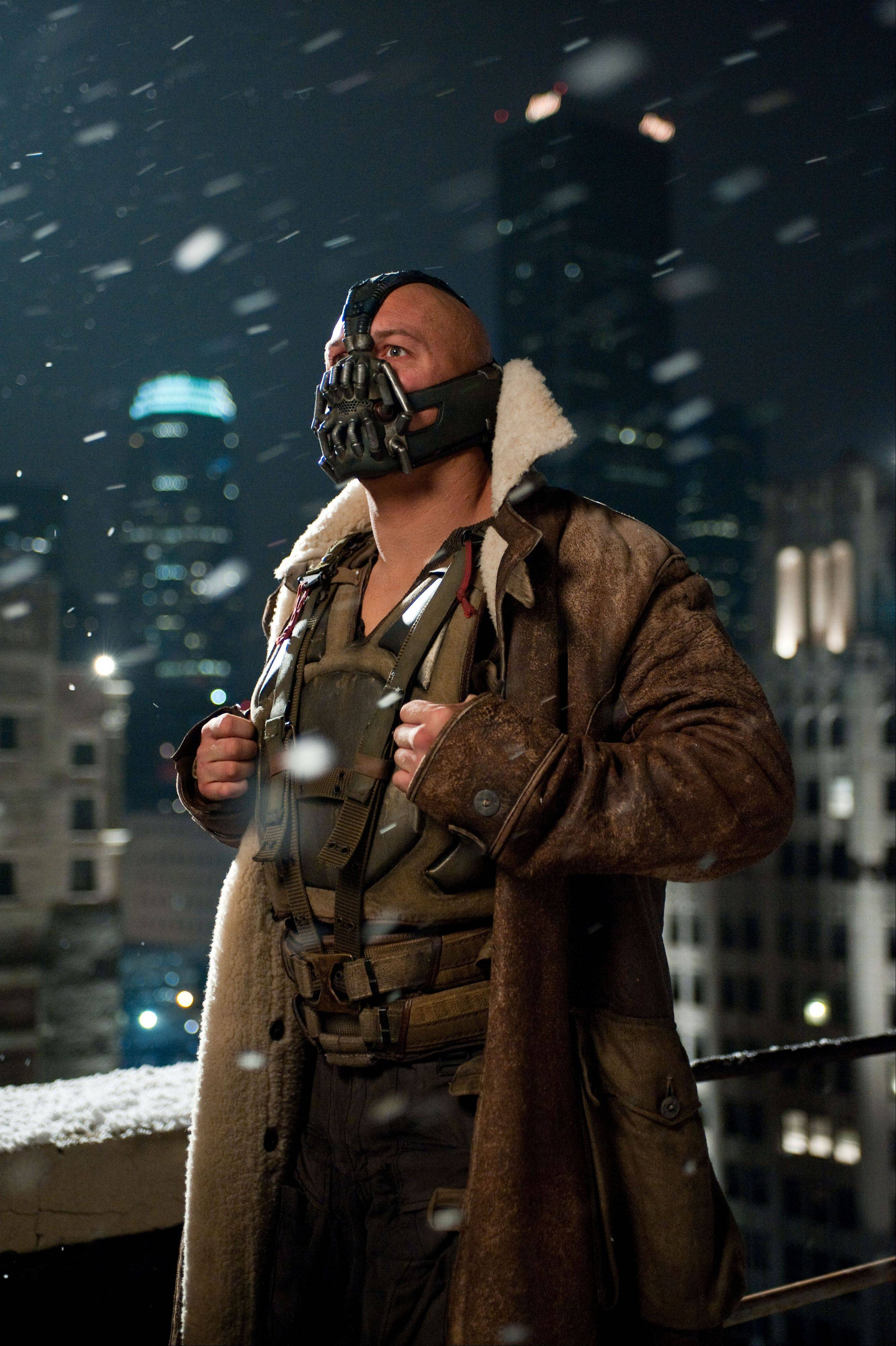 This undated film image released by Warner Bros. Pictures shows Tom Hardy as Bane in a scene from the action thriller �The Dark Knight Rises.� A gunman in a gas mask barged into a crowded Denver-area theater during a midnight premiere of the Batman movie on Friday, July 20, 2012, hurled a gas canister and then opened fire, killing 12 people and injuring at least 50 others in one of the deadliest mass shootings in recent U.S. history.