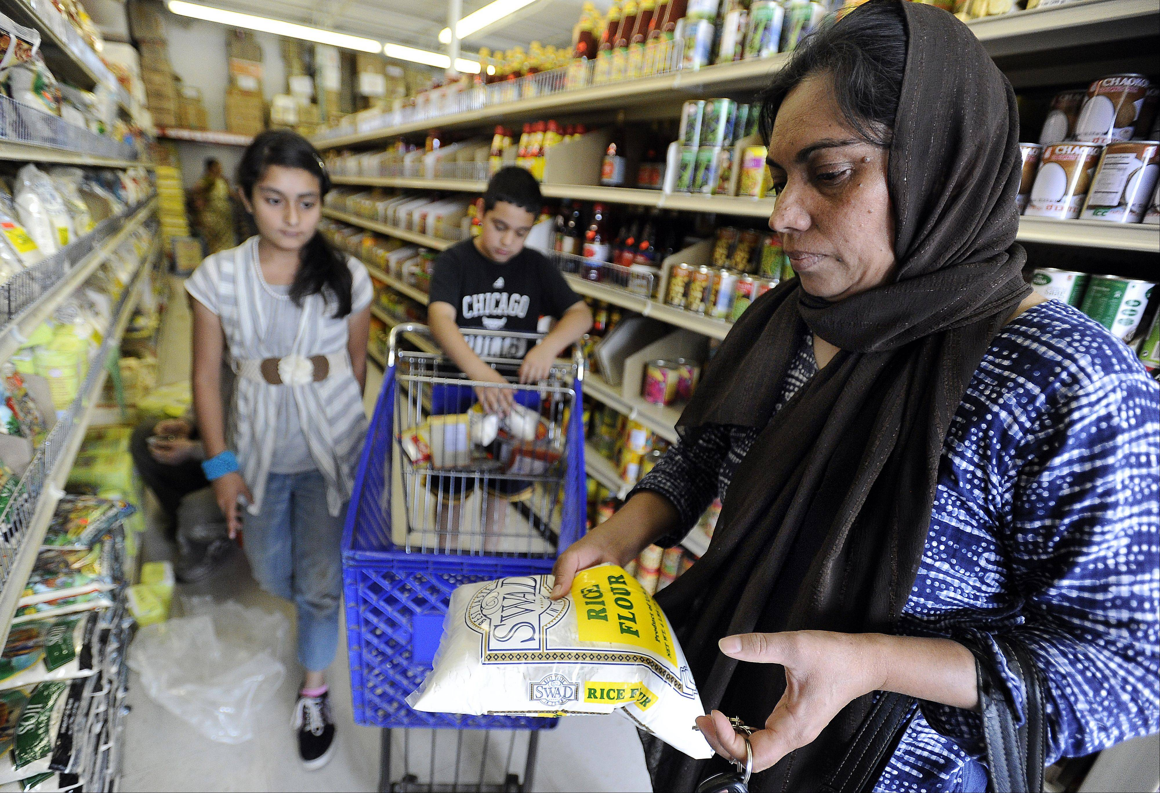 Naheed Umar of Hoffman Estates and her children, Zahid, 11, and Nameera, 10, shop for foods they will eat when they break their fast.