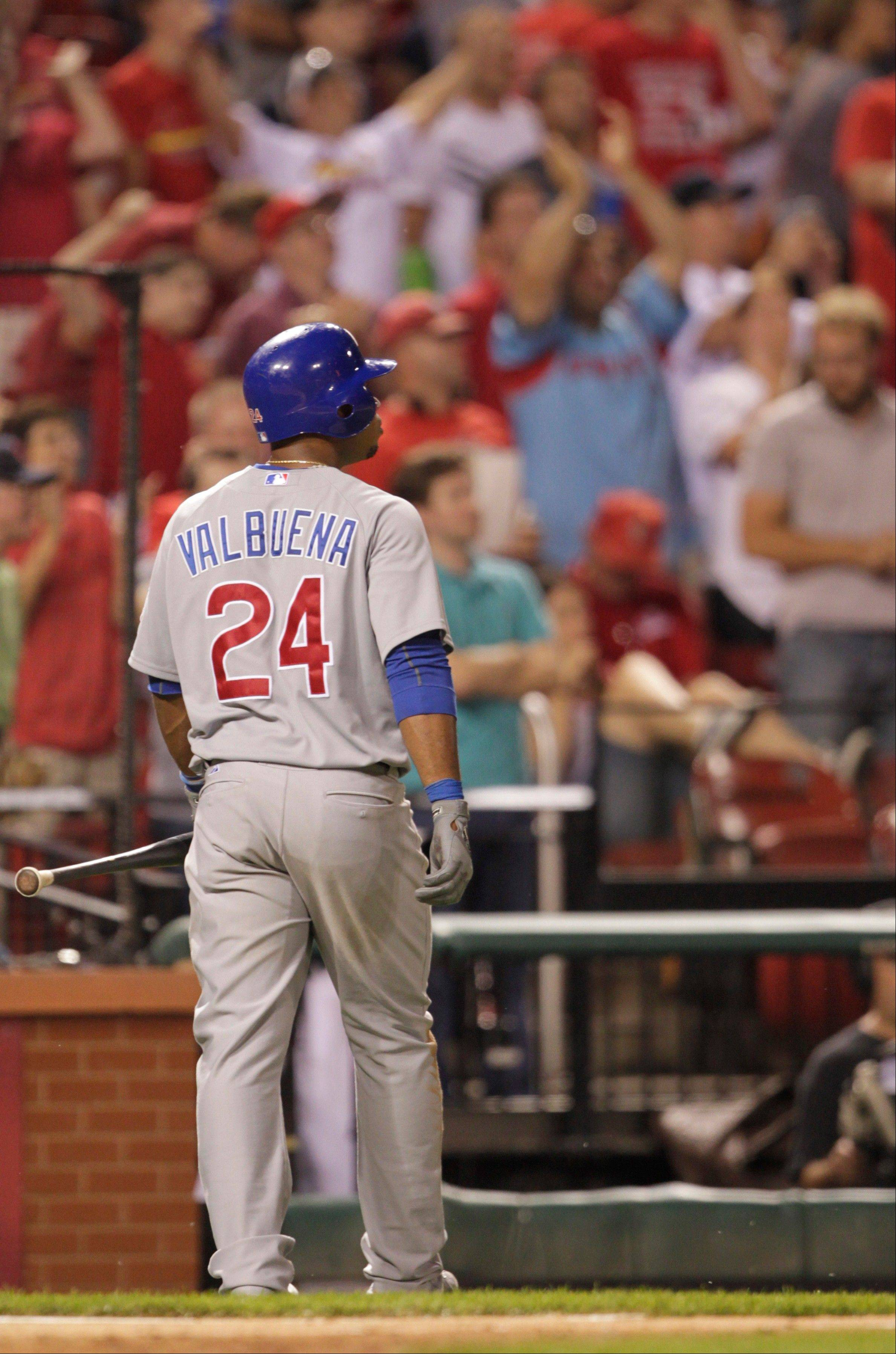 The Cubs� Luis Valbuena walks back to the dugout Friday after striking out to end the game.