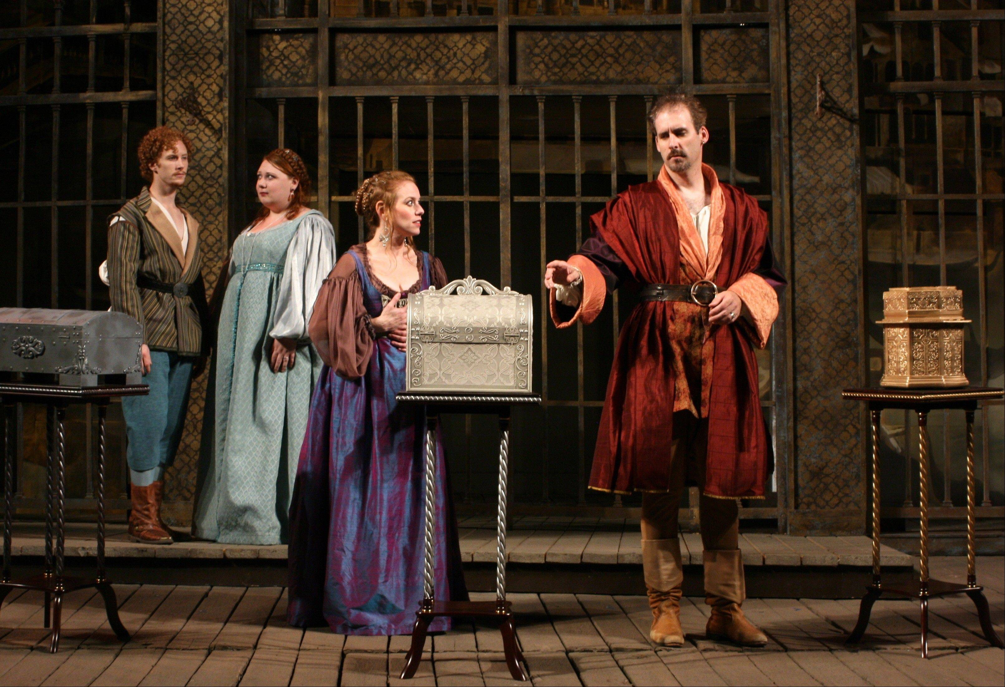 "Bassanio (Kevin McKillip, right) prepares to choose the casket that could win him the hand of Portia (Melanie Keller, second from right) in marriage while Gratiano (Kris Reilly, left) and Portia's lady-in-waiting Nerissa (Hayley L. Rice) look on in First Folio Theatre's ""The Merchant of Venice."""
