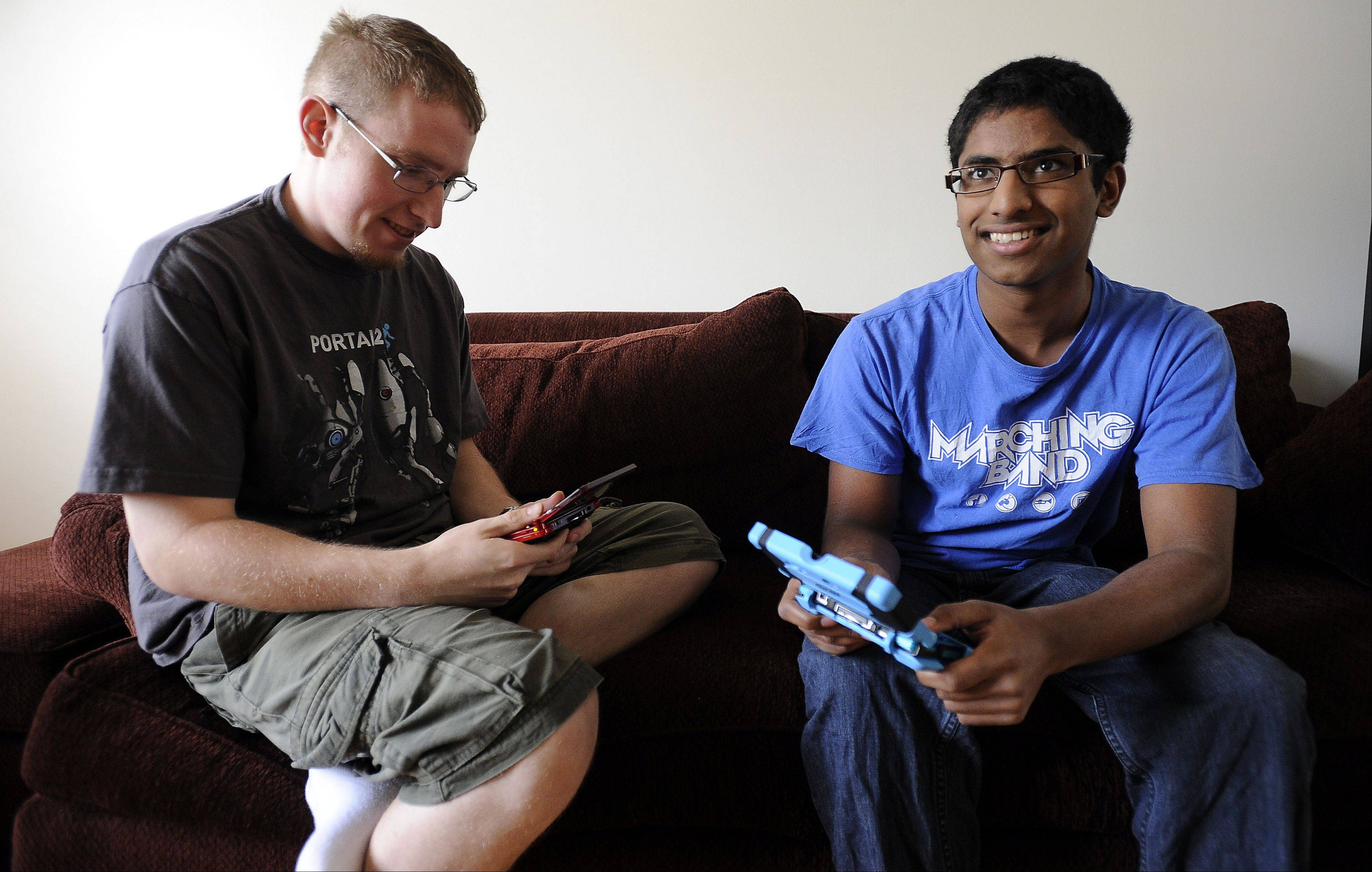 Manoj Sunny, 16, of Des Plaines is headed to Hawaii in August for the 2012 World Pokemon Championships. Here he practices with Eric Brooks, 20, of Des Plaines who keeps his skills sharp as they play the game.