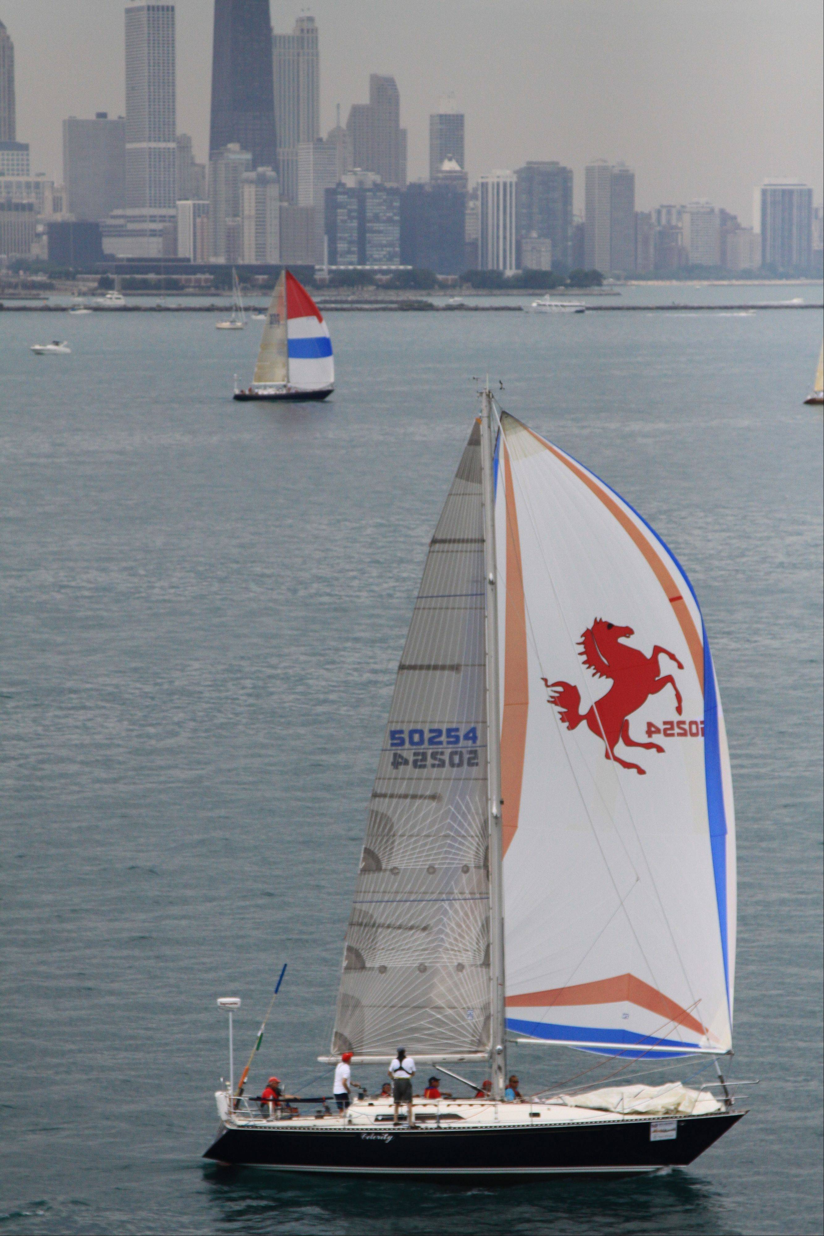 Shel Dummer, of Grayslake, and his crew aboard Celerity as it leaves Chicago during the 2011 race.