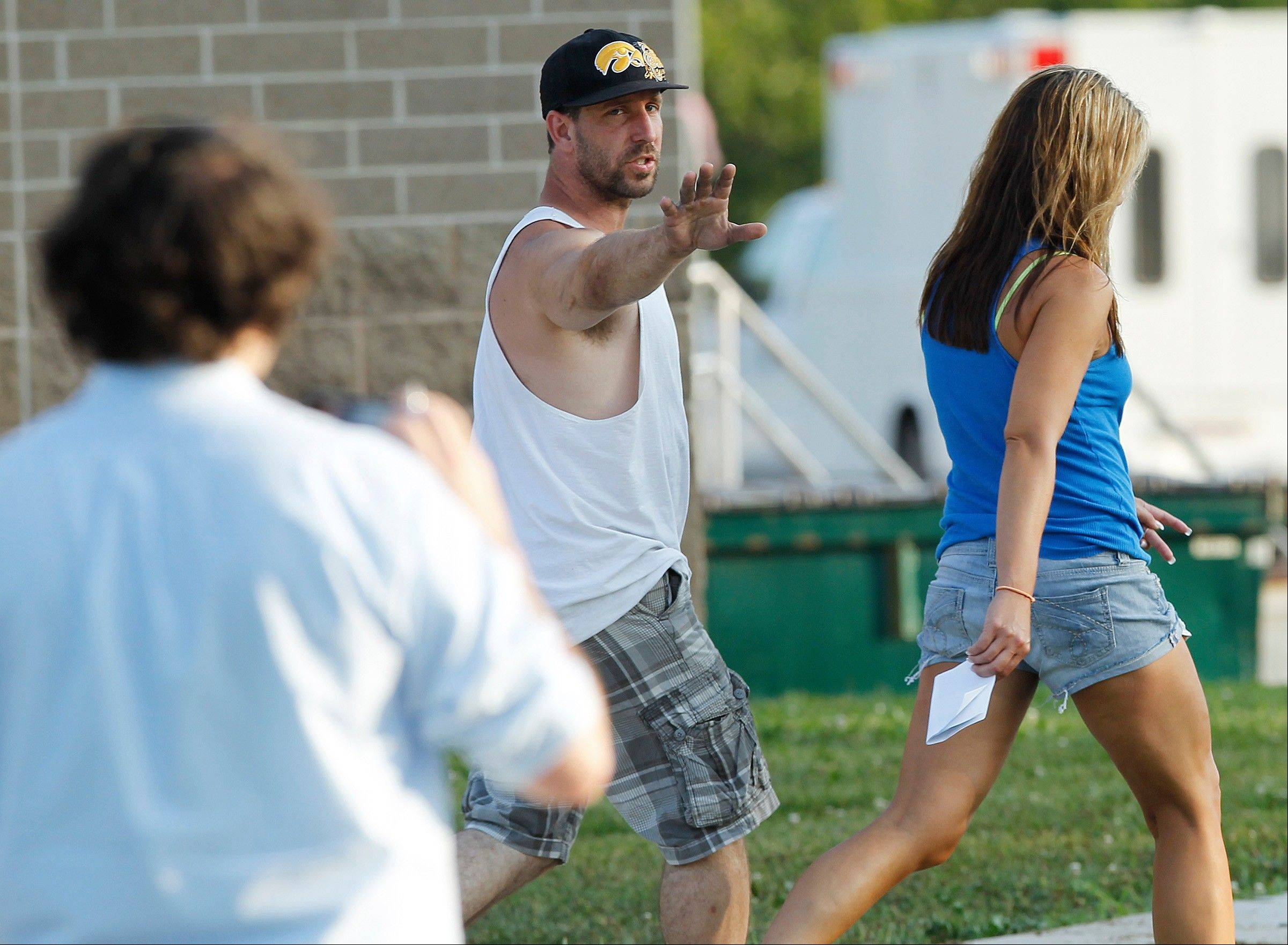 Dan and Misty Morrissey wave off the media as they walk out of the command center Thursday in Evansdale, Iowa.