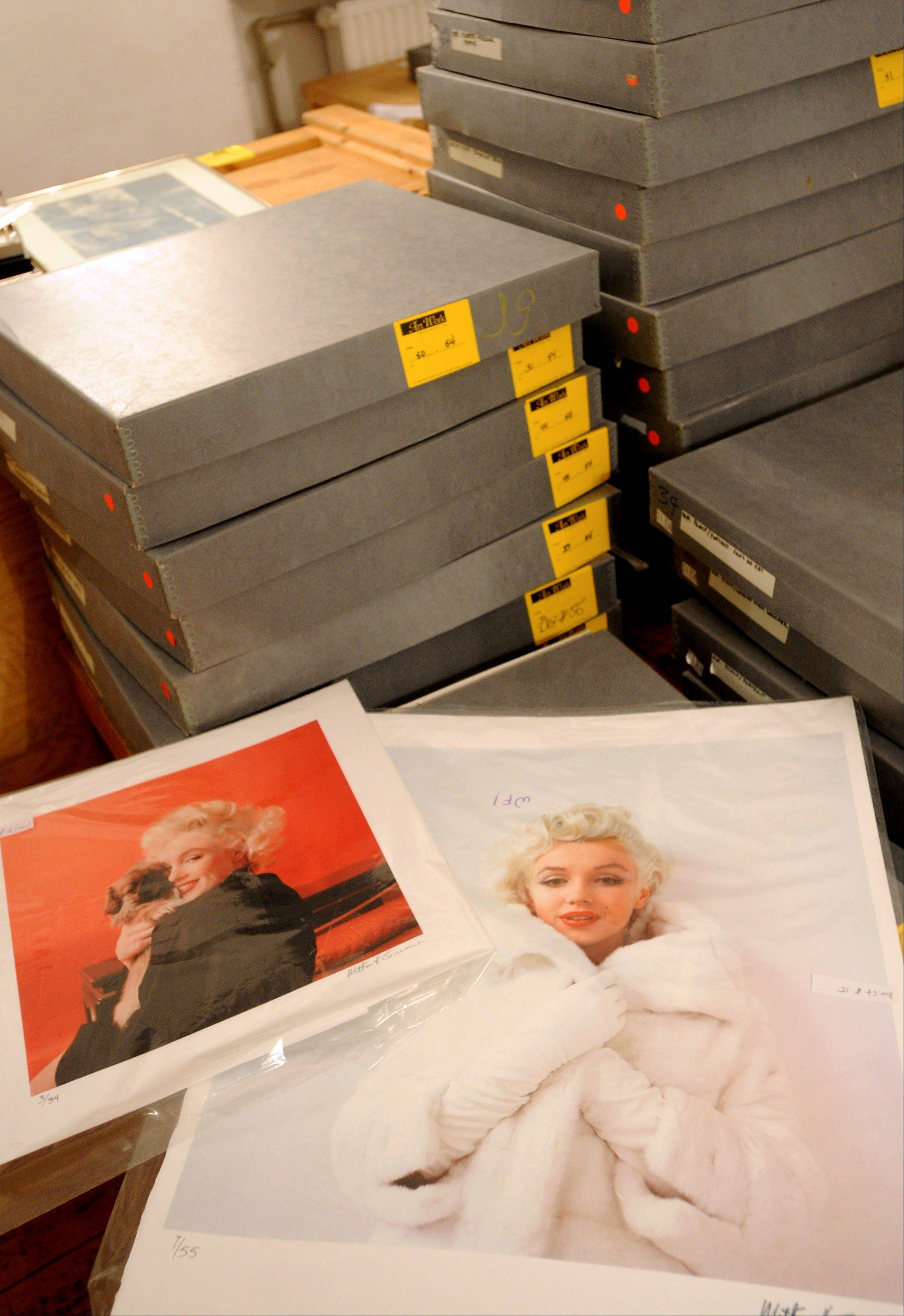 Two photos of Marylin Monroe by the late celebrity photographer Milton H. Greene are laid Friday upon boxes containing more pictures, in Warsaw, Poland.