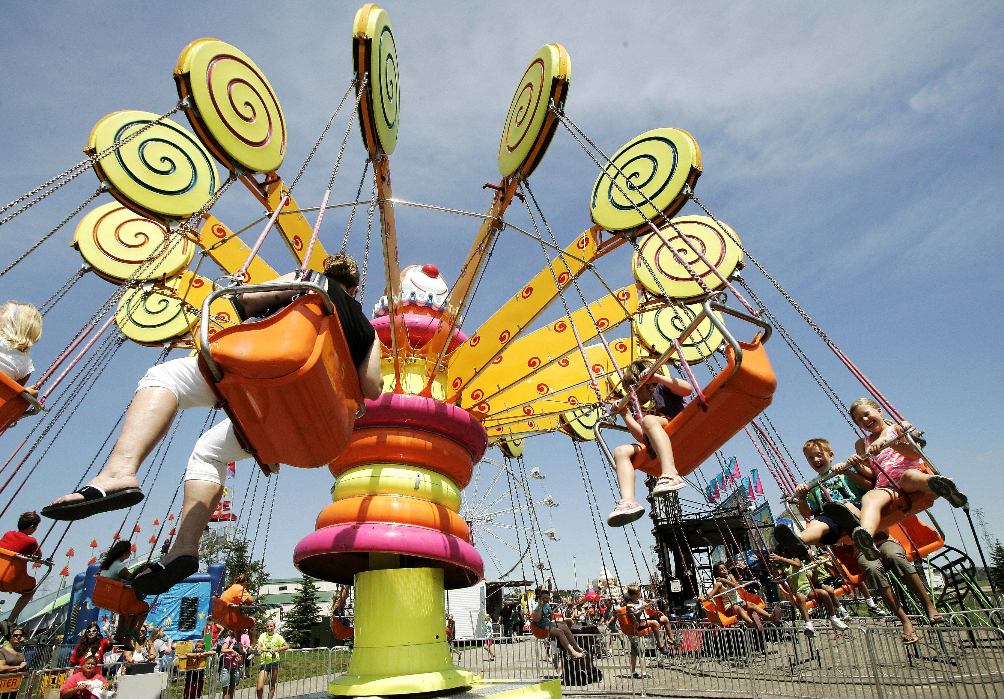 Gilbert R. Boucher II/gboucher@dailyherald.com, 2011Rides are a big attraction at the Lake County Fair in Grayslake.