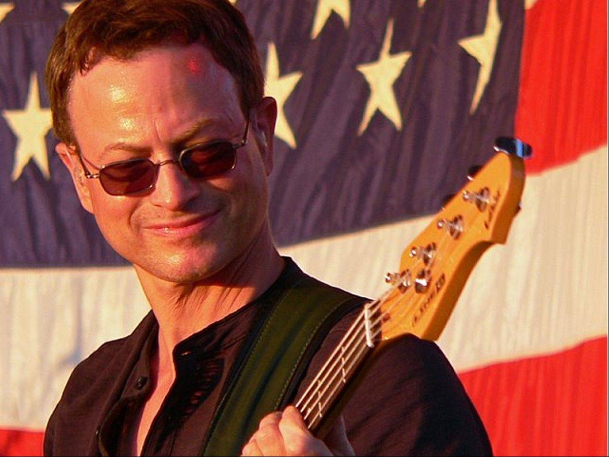 Gary Sinise and his Lt. Dan Band headline the annual Rockin' for the Troops concert to benefit Operation Support Our Troops, one of many performances the band gives to support the military.