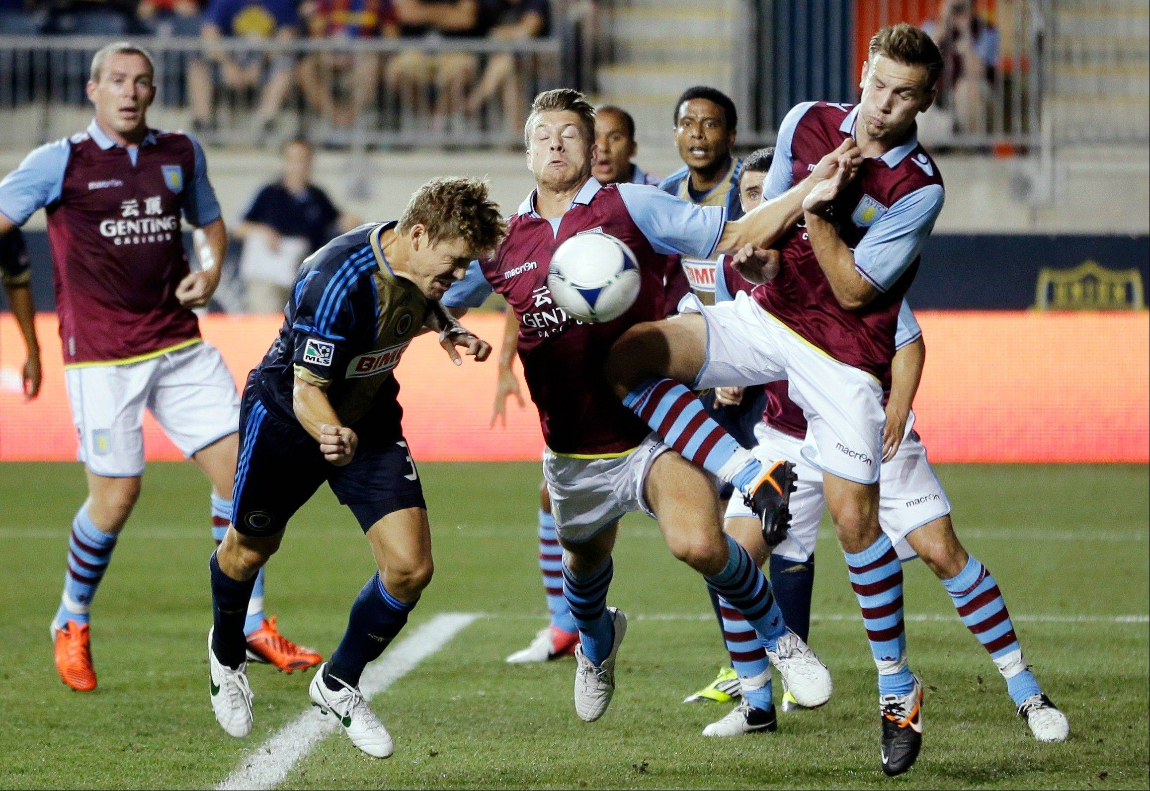 From left, Philadelphia Union's Chris Albright tries to head in the ball past Aston Villa's Nathan Baker and Andreas Weimann in a friendly soccer match Wednesday. Aston Villa, which won that match 1-0, plays the Fire at Toyota Park Saturday night.
