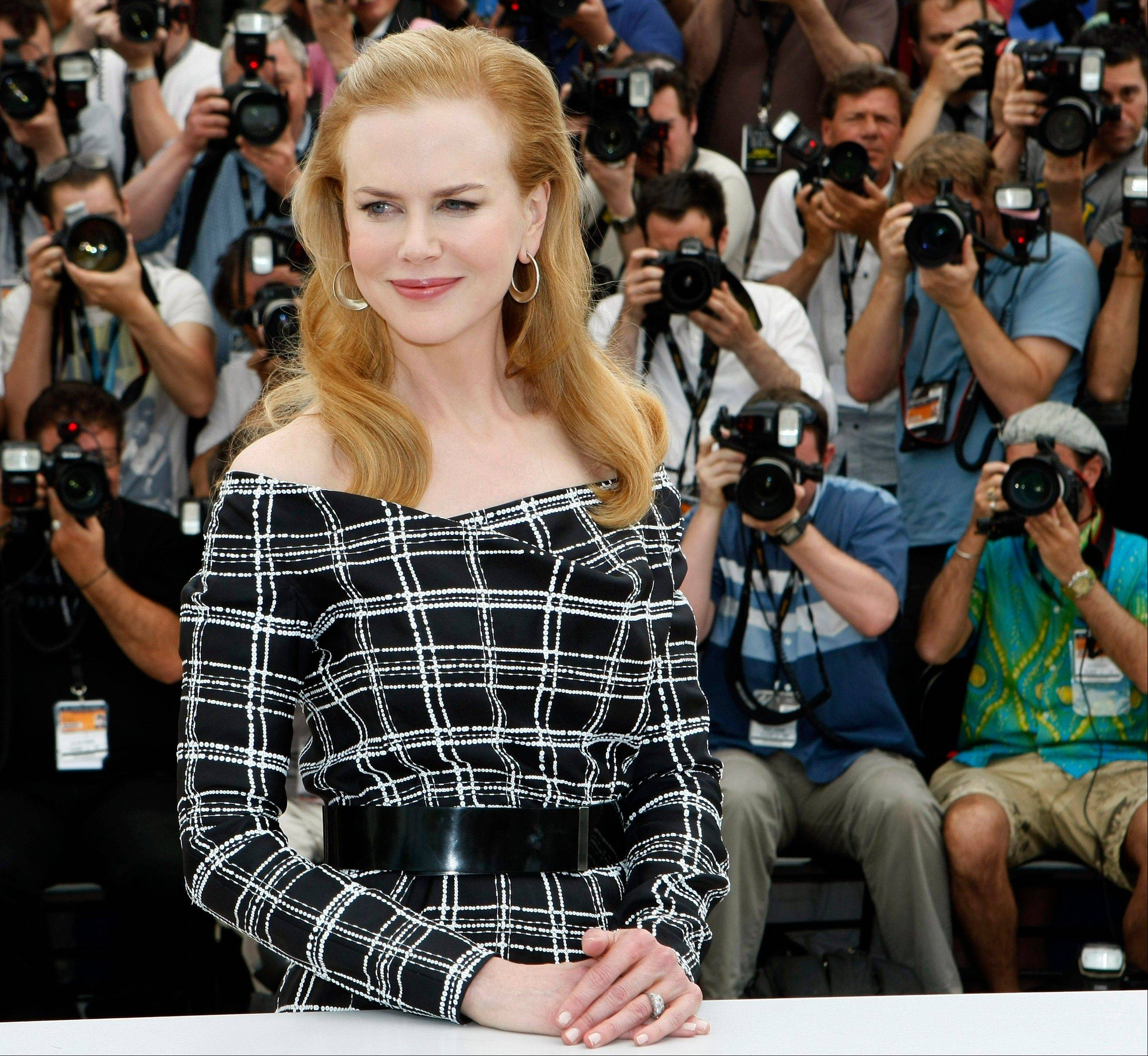 "Actress Nicole Kidman poses for photographers during a photo call for ""Hemingway & Gellhorn"" in Cannes, France, on May 25. At the London Olympics, Kidman is expected at a launch party July 28, while a space-themed bash on Aug. 2 will feature American astronauts Buzz Aldrin, Gene Cernan and Tom Stafford."