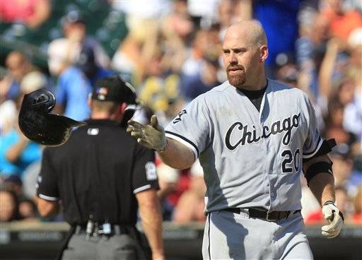 Kevin Youkilis isn't pleased after another strikeout in the sixth. The Sox fell out of first with a 7-1 loss to the Detroit Tigers Saturday at Comerica Park.