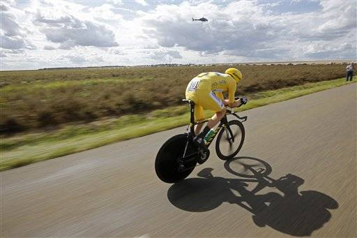 Bradley Wiggins all but sealed the Tour de France title Saturday, capturing the final time trial with a commanding show of authority.