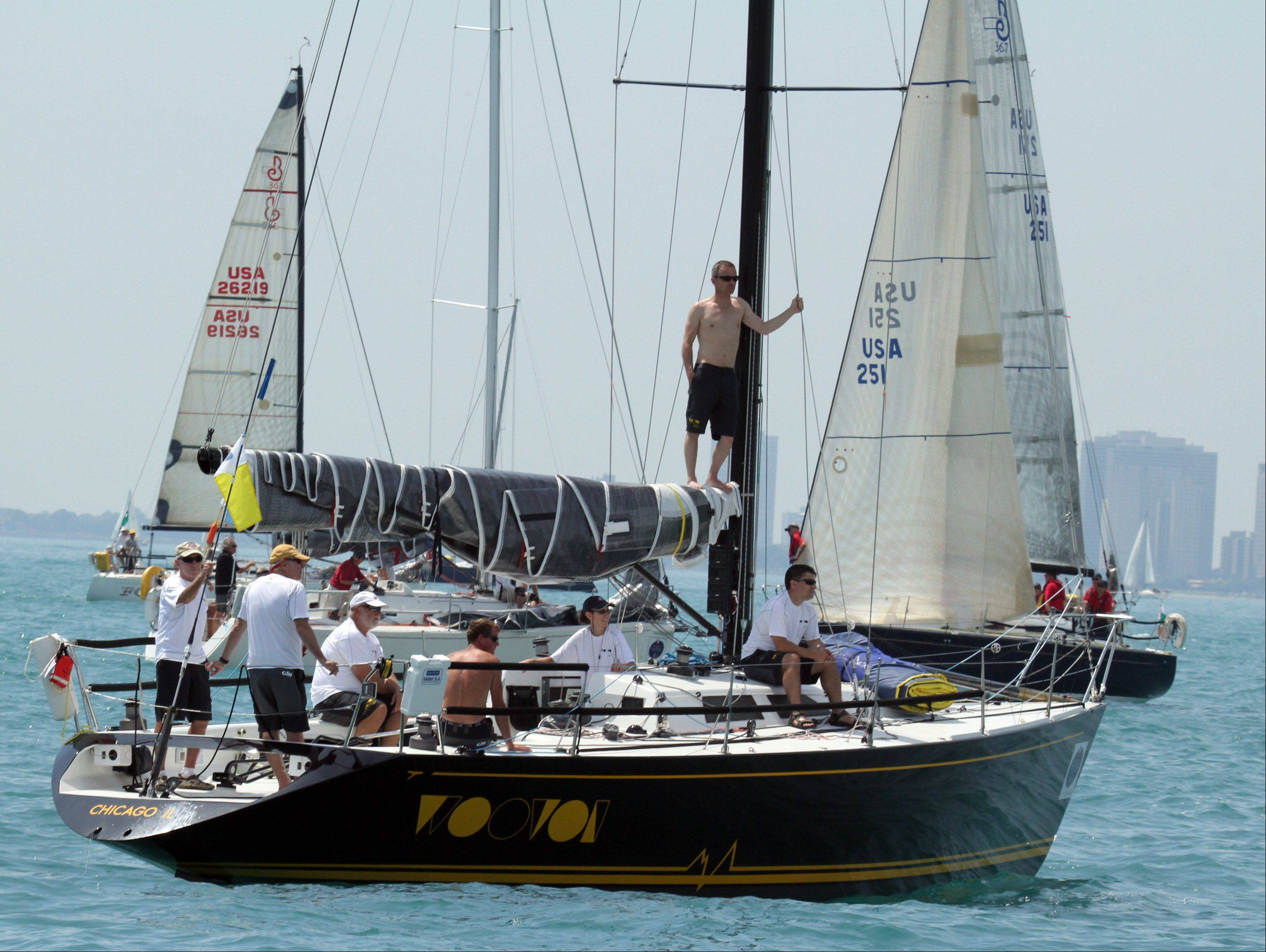 Crew members wait for the start of the 104th Chicago Yacht Club Race to Mackinac on Lake Michigan on Saturday, July 21.