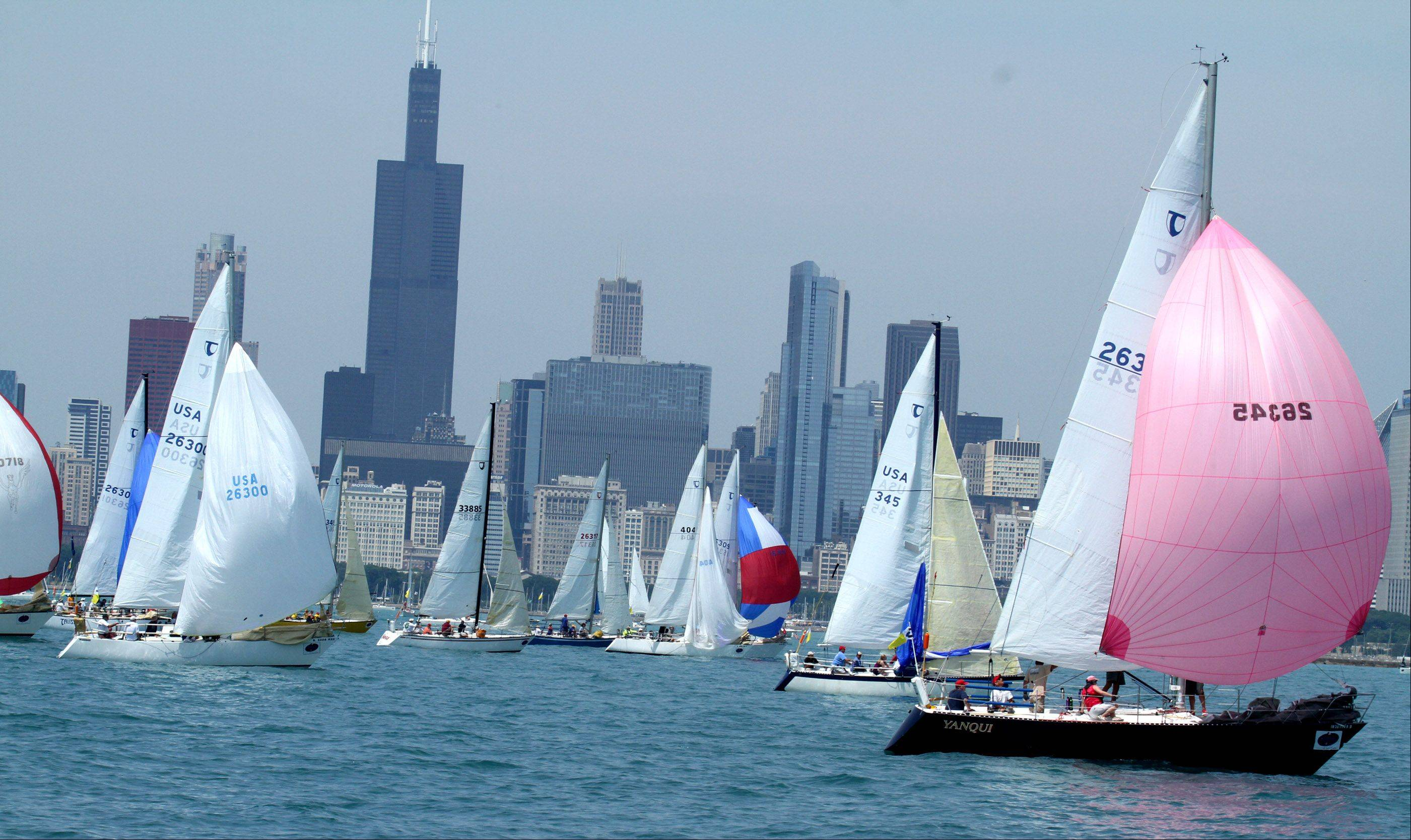 The 104th Chicago Yacht Club Race to Mackinac travels past the Chicago Skyline.