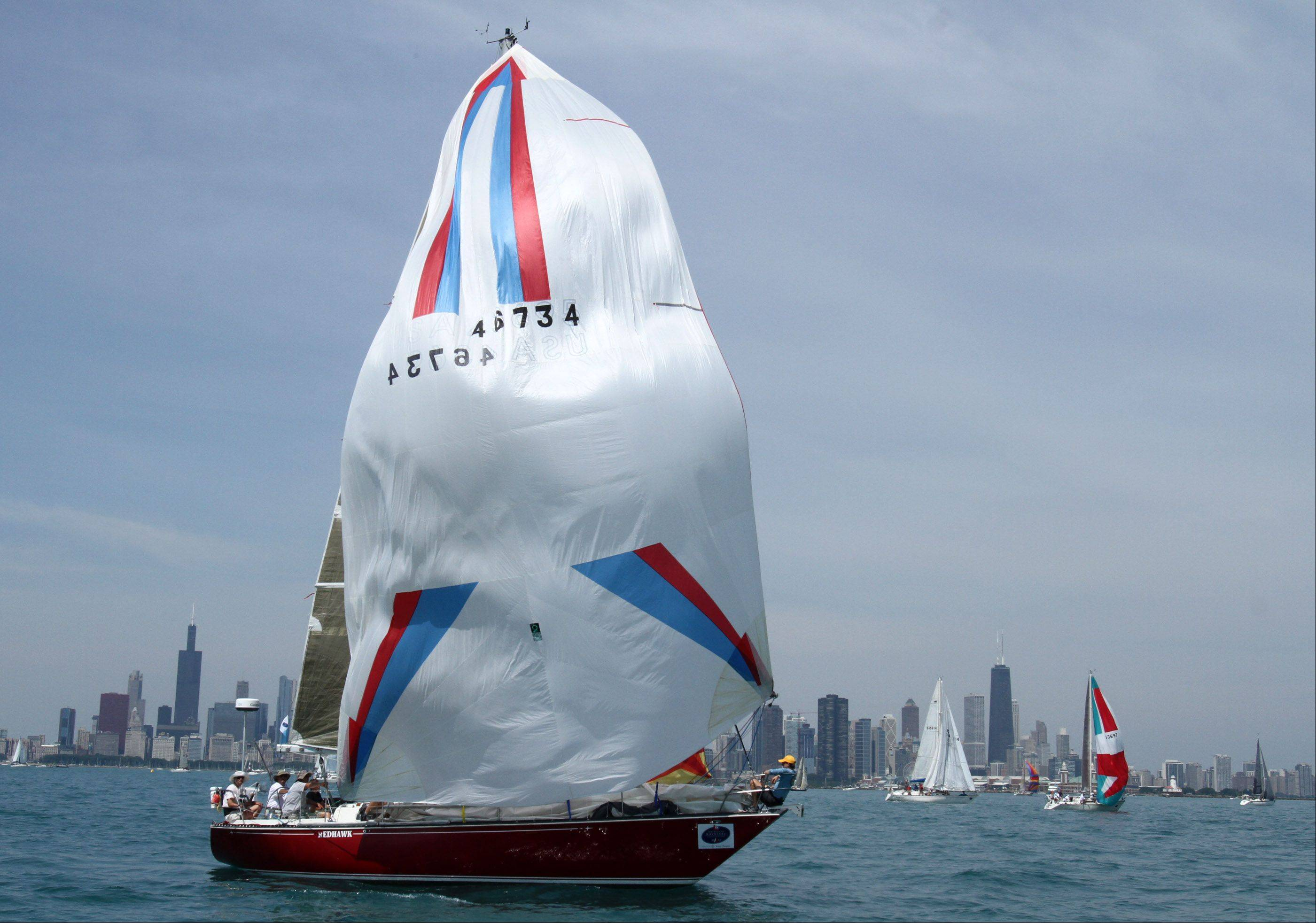 Redhawk owned by Mark Janda, of Bloomington, MN, with Wayzata Yacht Club gets a little wind in her sail at the start of the 104th Chicago Yacht Club Race to Mackinac on Lake Michigan of Chicago on Saturday, July 21.