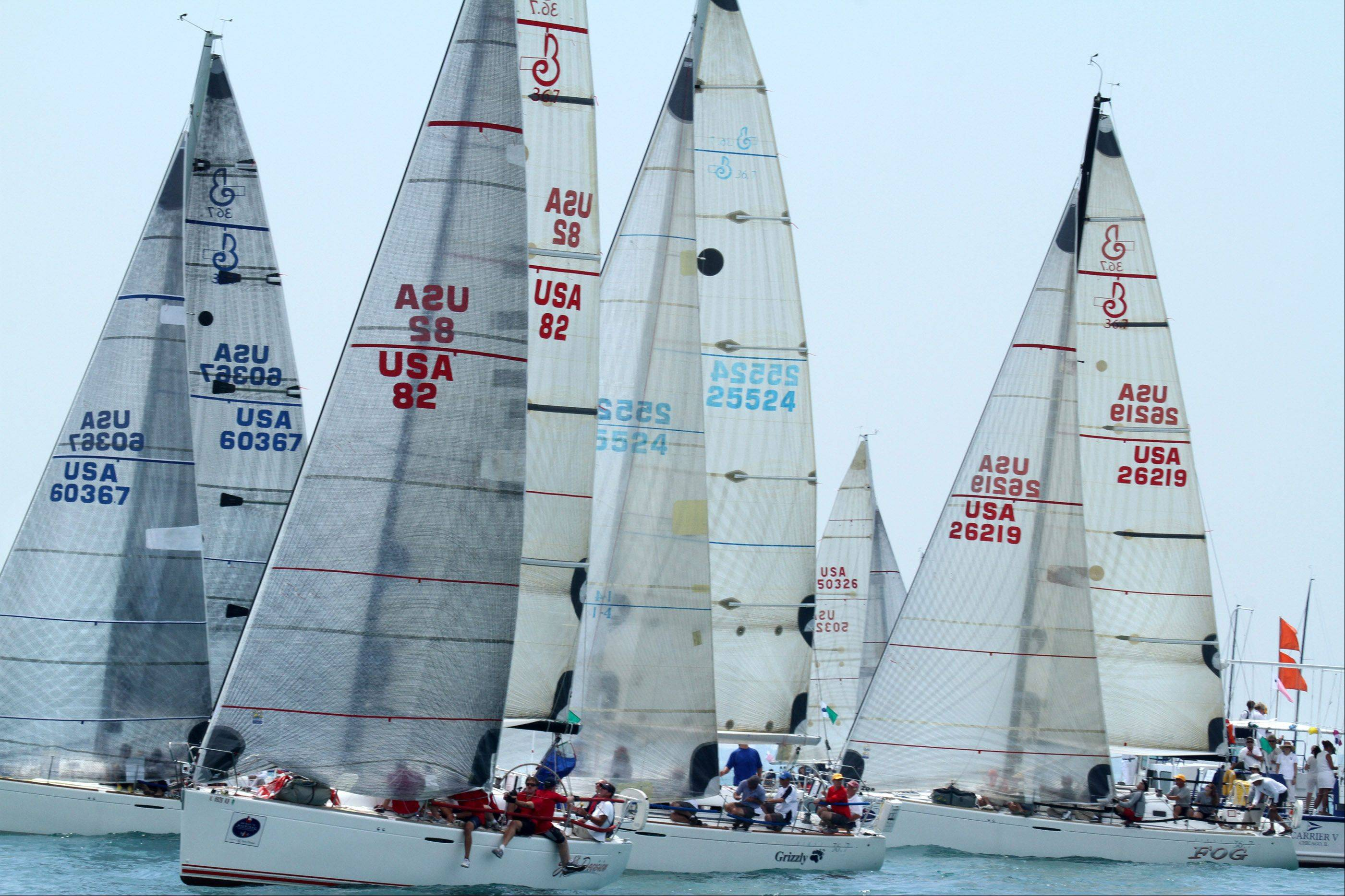 With little to wind sailboats, including Split Decision, second from left, USA 82, owned by Mark Norris of Chicago, with Chicago Yacht Club, were bunched up at the start of the 104th Chicago Yacht Club Race to Mackinac on Lake Michigan of Chicago on Saturday, July 21.