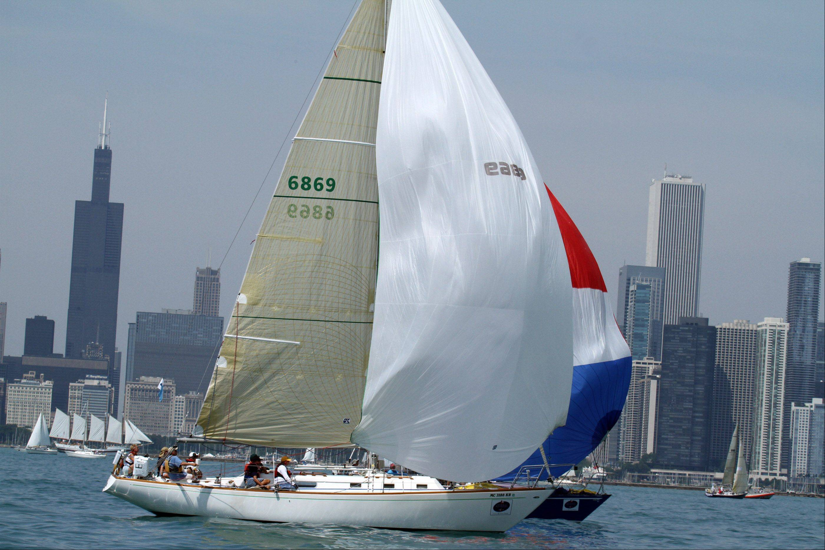 Cynthia, USA 6869, owned by Andrew Grootendorst and James DeVries of Coloma, Michigan, with St Joseph River Yacht Club, at the start of the 104th Chicago Yacht Club Race to Mackinac on Lake Michigan of Chicago on Saturday, July 21.