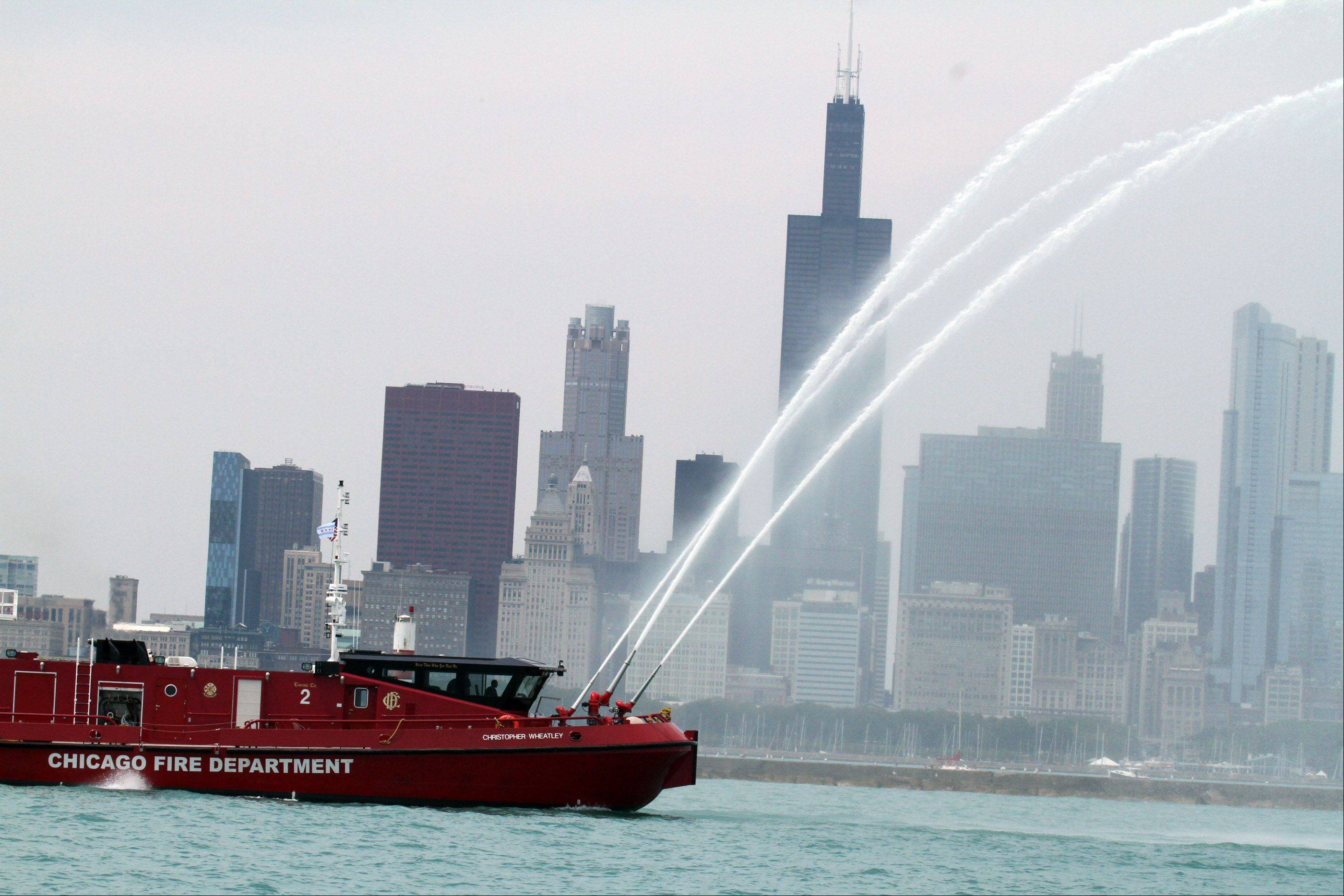 A Chicago Fire Department boat was on on hand spraying water across the Chicago skyline before the start of the 104th Chicago Yacht Club Race to Mackinac on Lake Michigan of Chicago on Saturday, July 21.