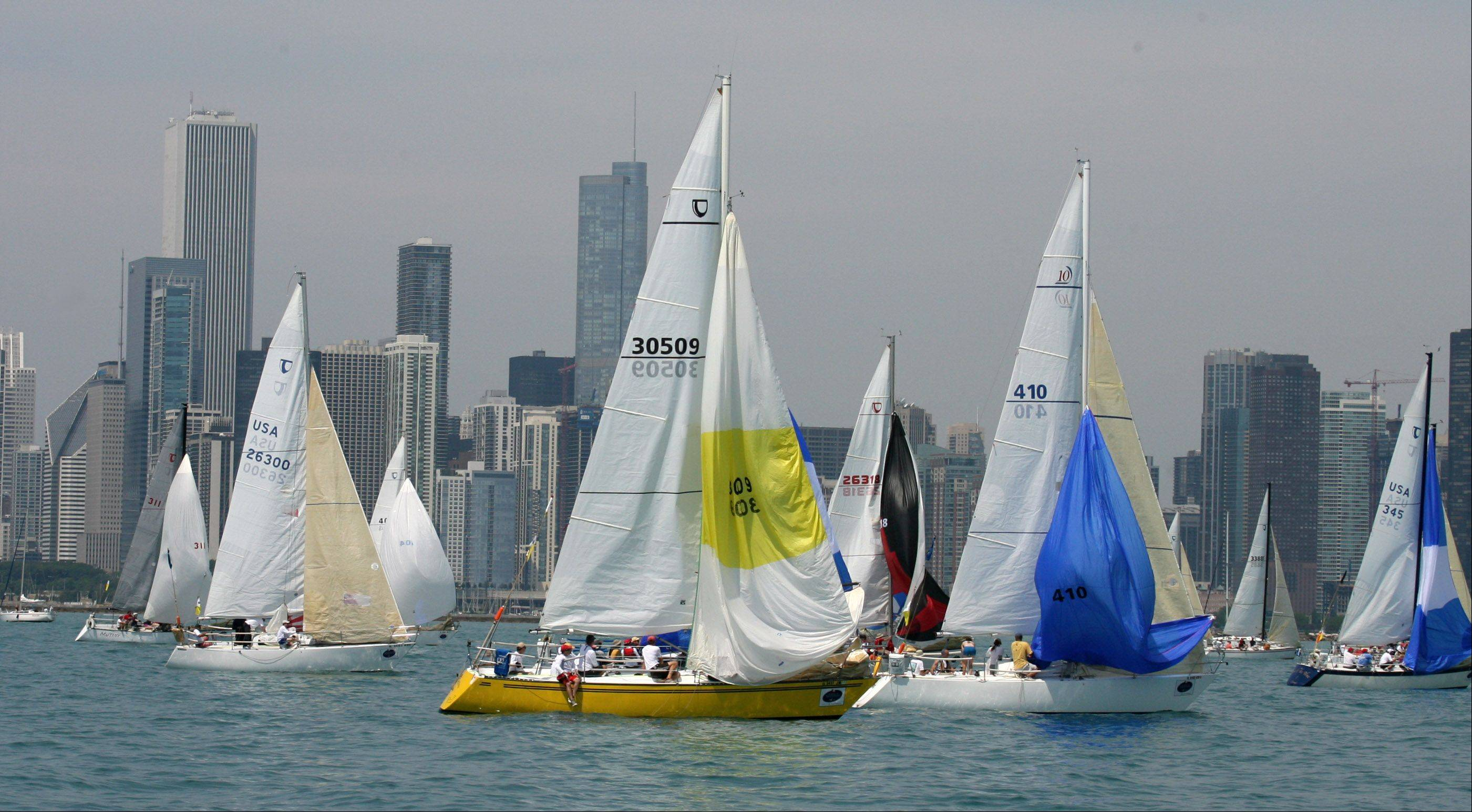 Grytviken, USA 30509, center yellow, owned by Piotr Madrzyk, of Bloomingdale, with the Polish Yacht Club Chicago, at the start of the 104th Chicago Yacht Club Race to Mackinac on Lake Michigan near Chicago on Saturday, July 21.