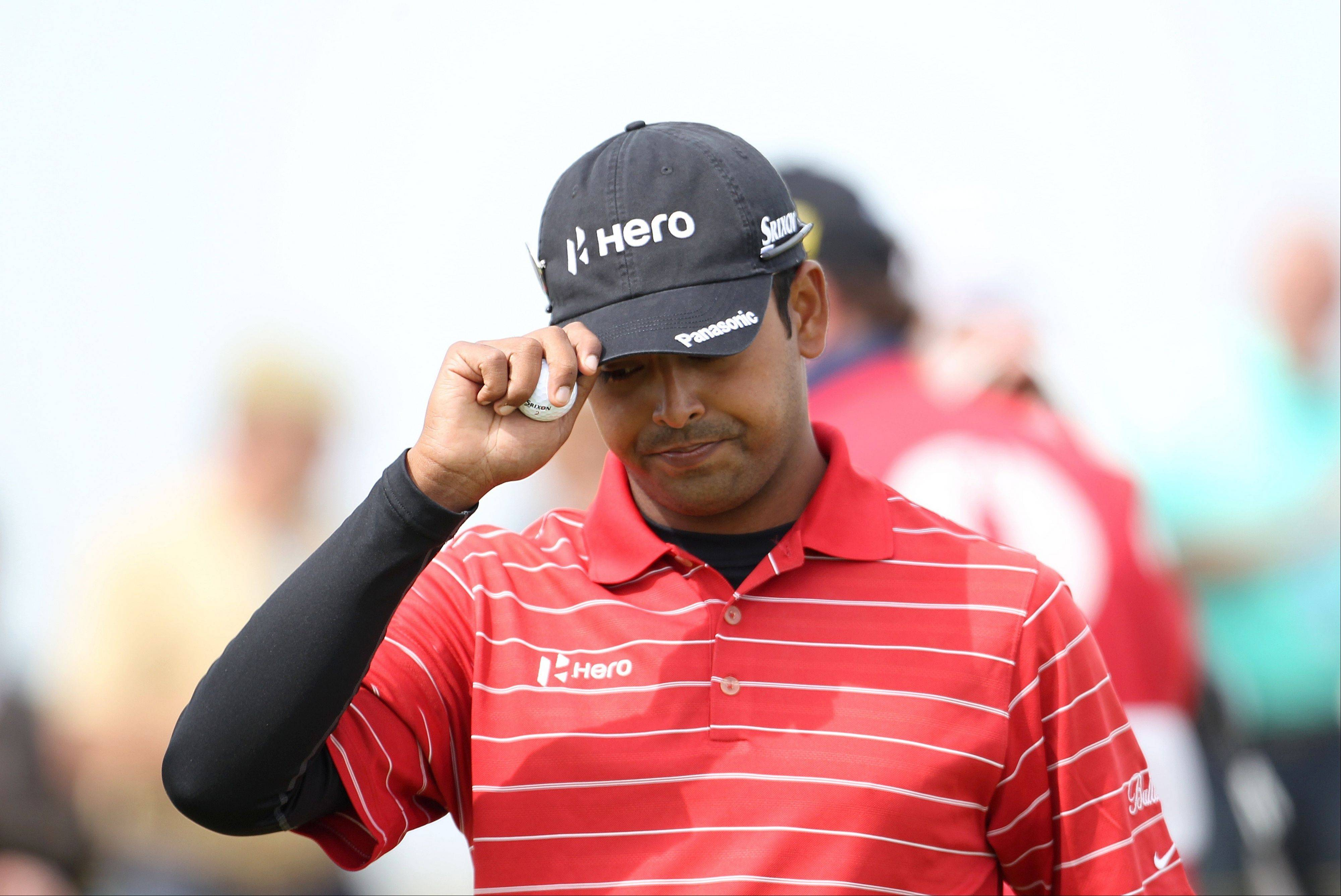 India's Anirban Lahiri acknowledges applause Saturday from the gallery during day three of the 2012 Open Championship at Royal Lytham & St. Annes Golf Club, Lytham & St Annes. The 25-year-old Indian, making his Open debut, made the first hole in one of the 2012 tournament Saturday on the par-3 ninth hole from 150 yards.
