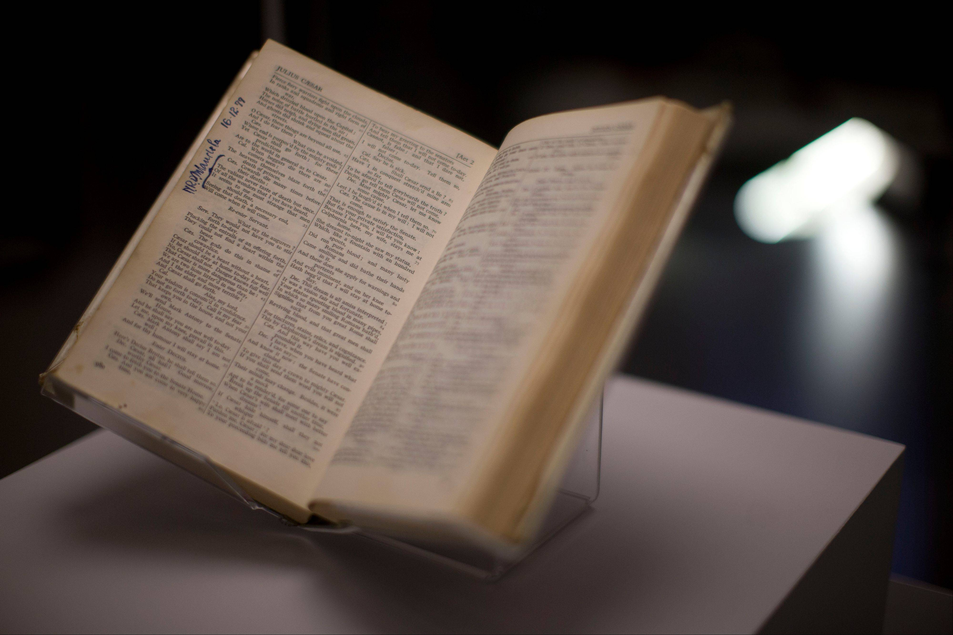 "A copy of the ""Complete Works of Shakespeare"" is displayed and signed by Nelson Mandela and owned by Sonny Venkatrathnam, who was imprisoned on Robben Island in South Africa, during the press view of the ""Shakespeare: staging the world"" exhibition at the British Museum in London, Wednesday, July 18, 2012. The exhibition, which is being held as part of the London 2012 cultural Olympiad, provides a unique insight into the emerging role of London as a world city 400 years ago, seen through the innovative perspective of Shakespeare's plays. It runs from July 19 to November 25."