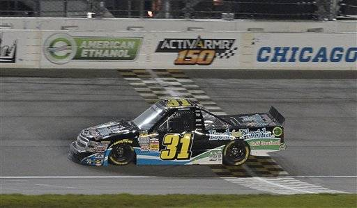 James Buescher crosses the finish line to win the NASCAR Camping World Truck Series auto race at Chicagoland Speedway in Joliet Saturday.