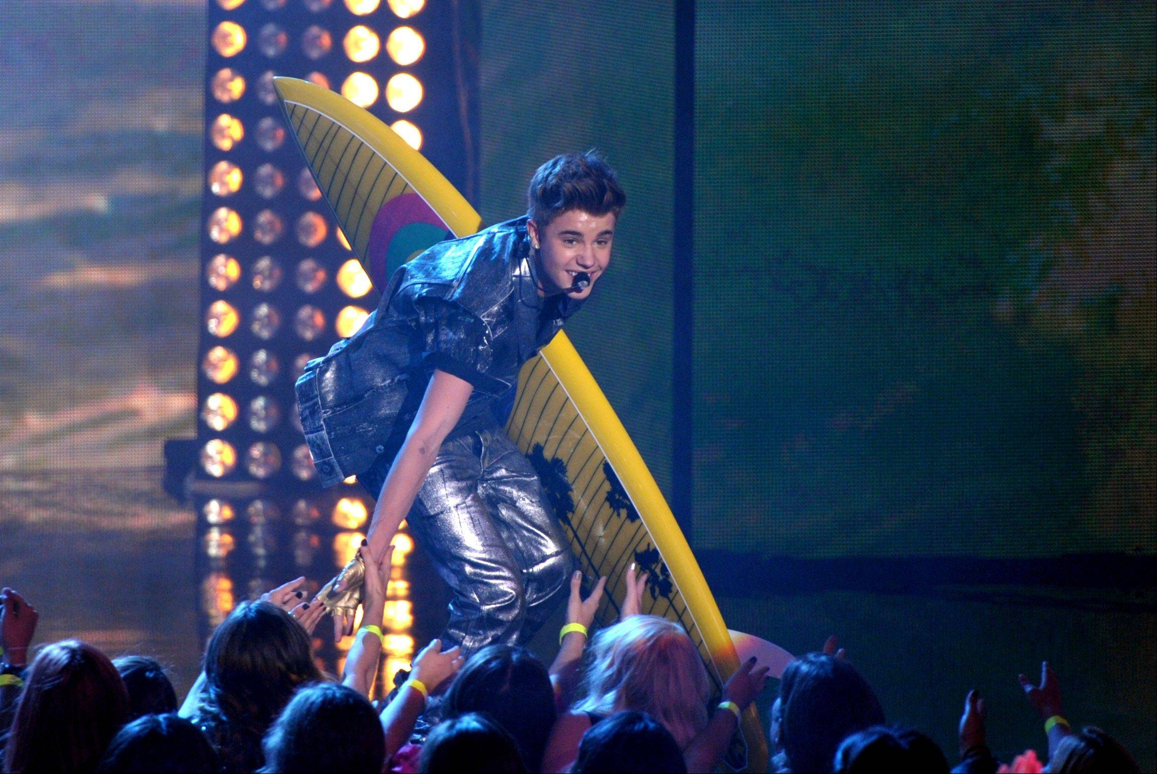 Justin Bieber performs onstage at the Teen Choice Awards on Sunday in Universal City, Calif.