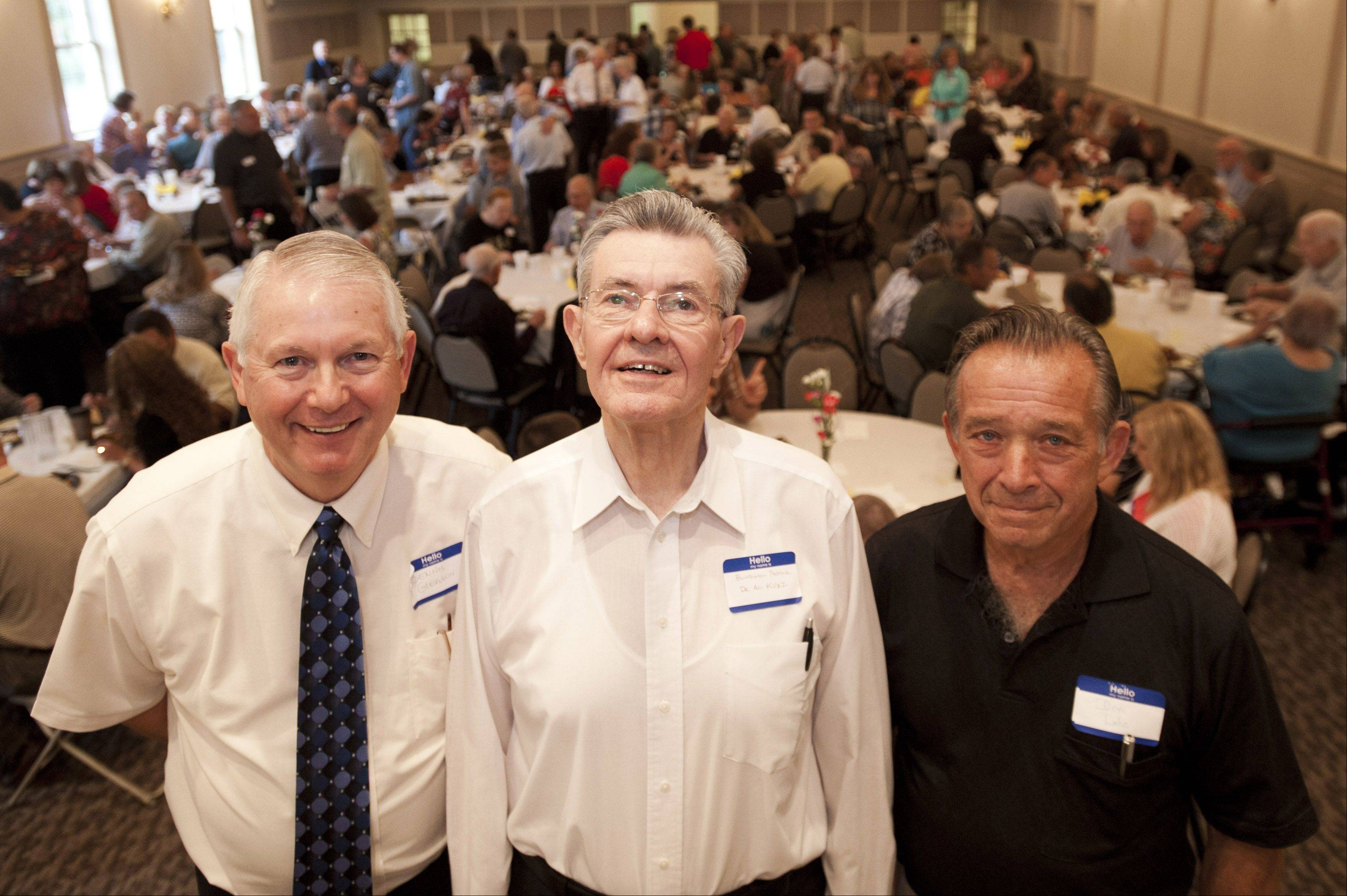 Former pastors of the Addison Bible Church, Dennis Gleason, Al Kurz and Don Lake, gather with more than 200 members for a reunion Sunday in Medinah.