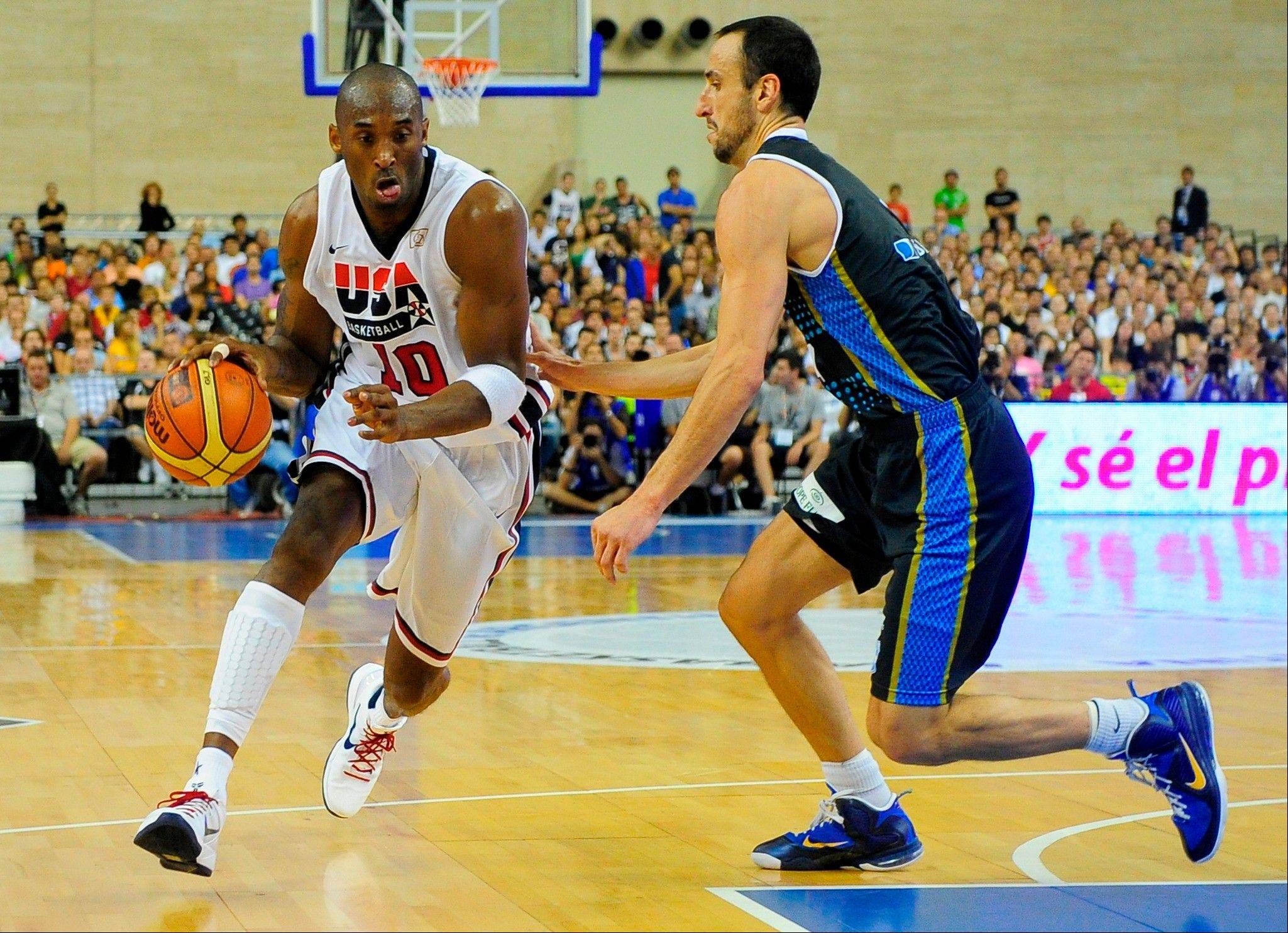 The U.S. team�s Kobe Bryant drives against Argentina�s Emmanuel Ginobili during their exhibition game Sunday in Barcelona, Spain.