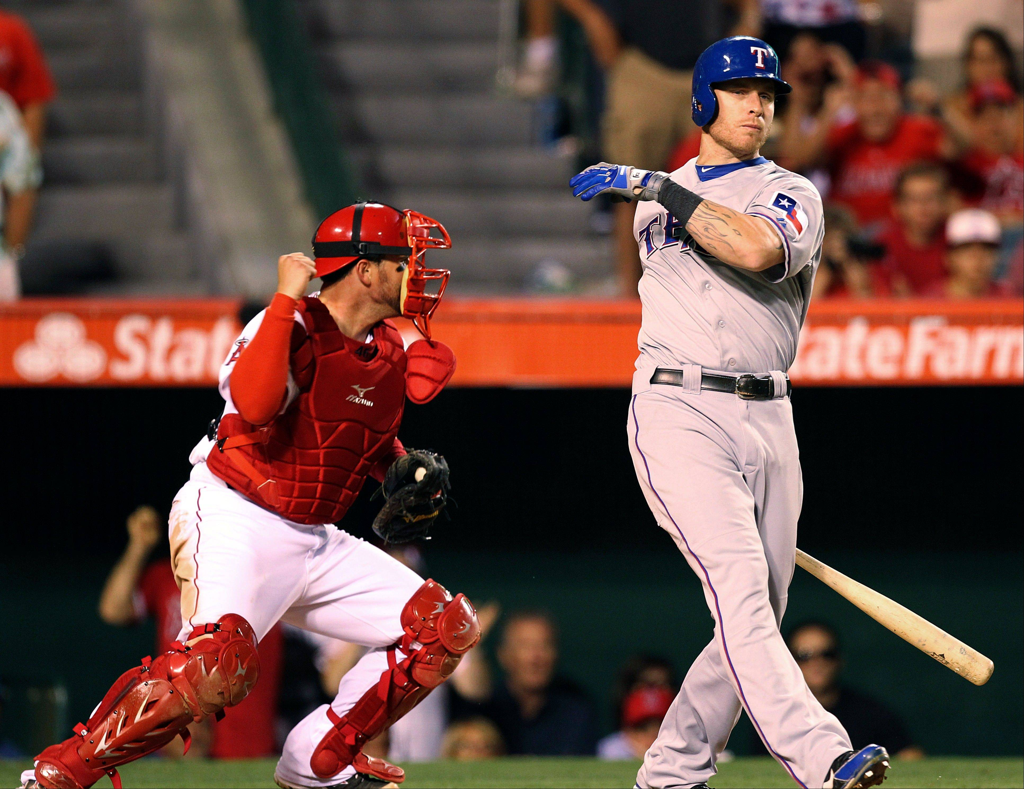 The Rangers� Josh Hamilton strikes out swinging for the final out as Angels catcher Bobby Wilson begins to celebrate a 7-4 win Sunday in Anaheim, Calif.