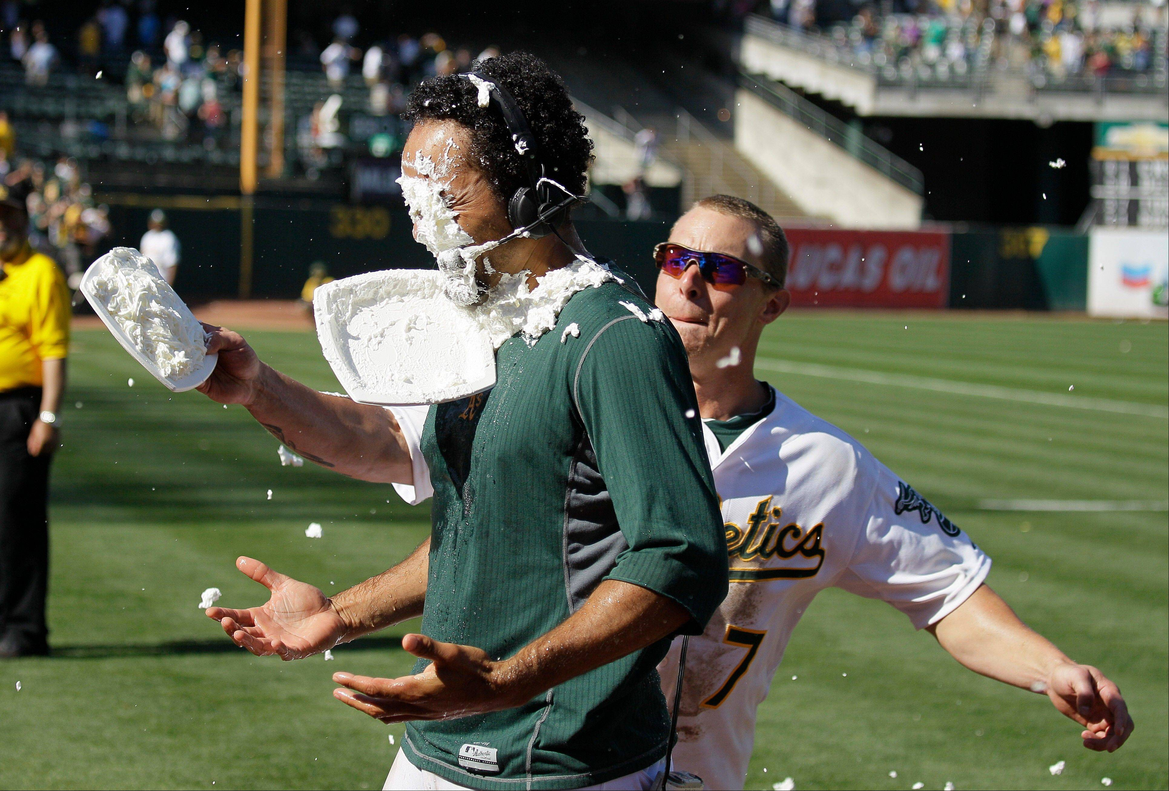 Brandon Inge, right, hits teammate Coco Crisp with a shaving cream pie Sunday after Oakland beat the New York Yankees at home. Crisp drove in the game-winning run.