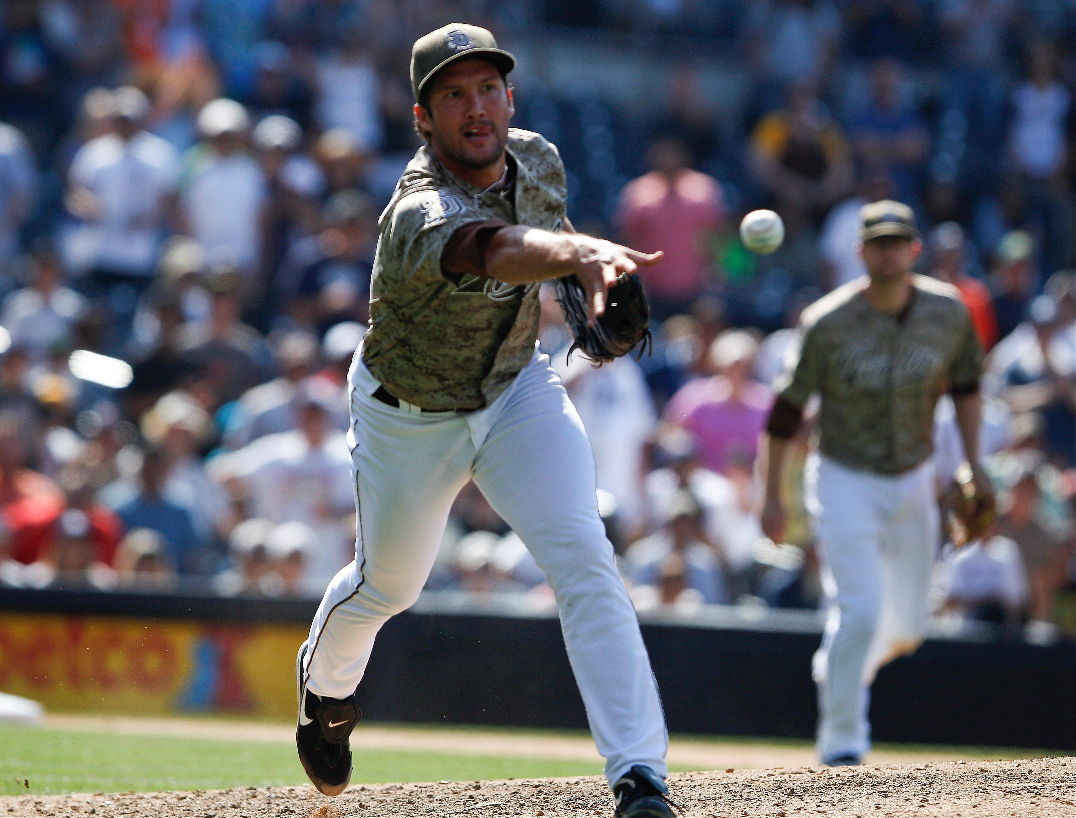 San Diego closer Huston Street makes the flip to first to get Colorado�s Jordan Pacheco for the final out of the Padres� 3-2 victory Sunday at home.