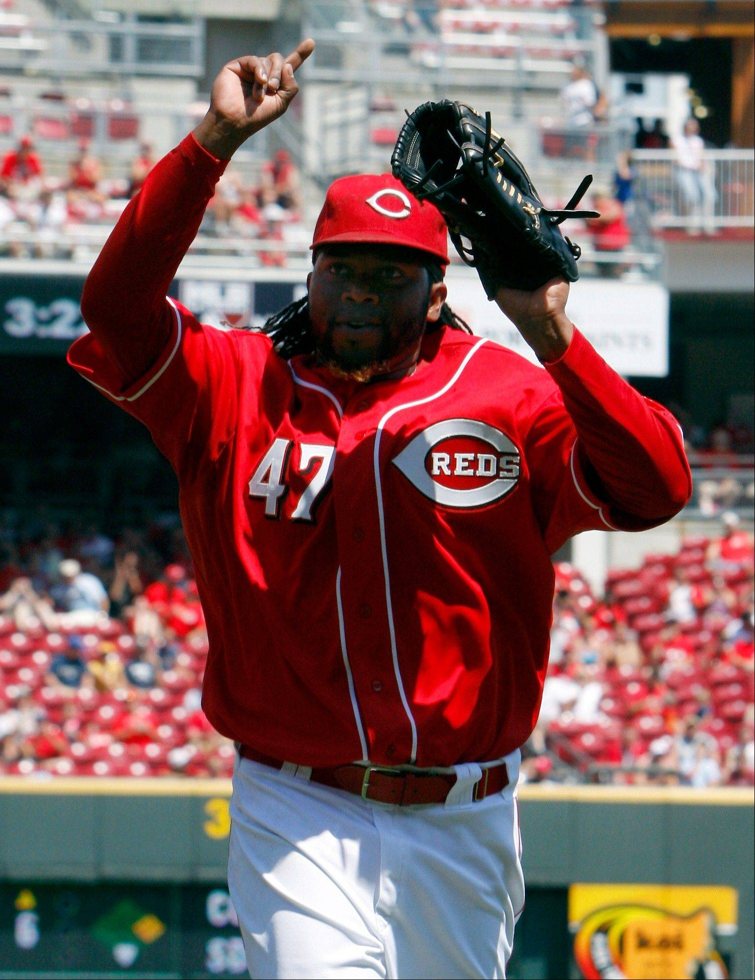 Cincinnati starting pitcher Johnny Cueto walks off the field in the seventh inning Sunday at home against Milwaukee Brewers. The Reds won 2-1.
