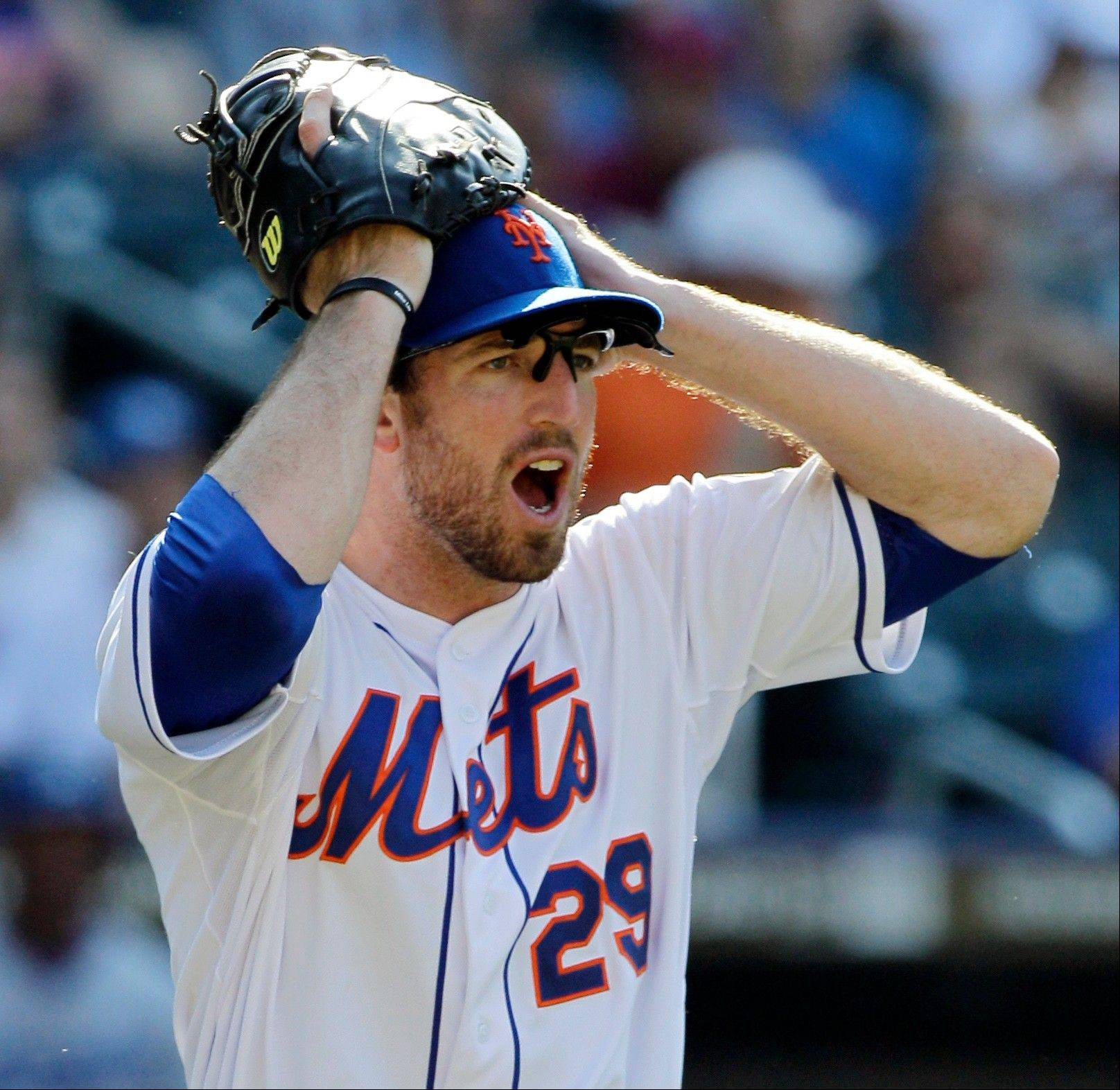 Mets first baseman Ike Davis protests after first base umpire Mike Dimuro called the Dodgers� Tony Gwynn Jr. safe on a 12th-inning bunt single Sunday in New York.