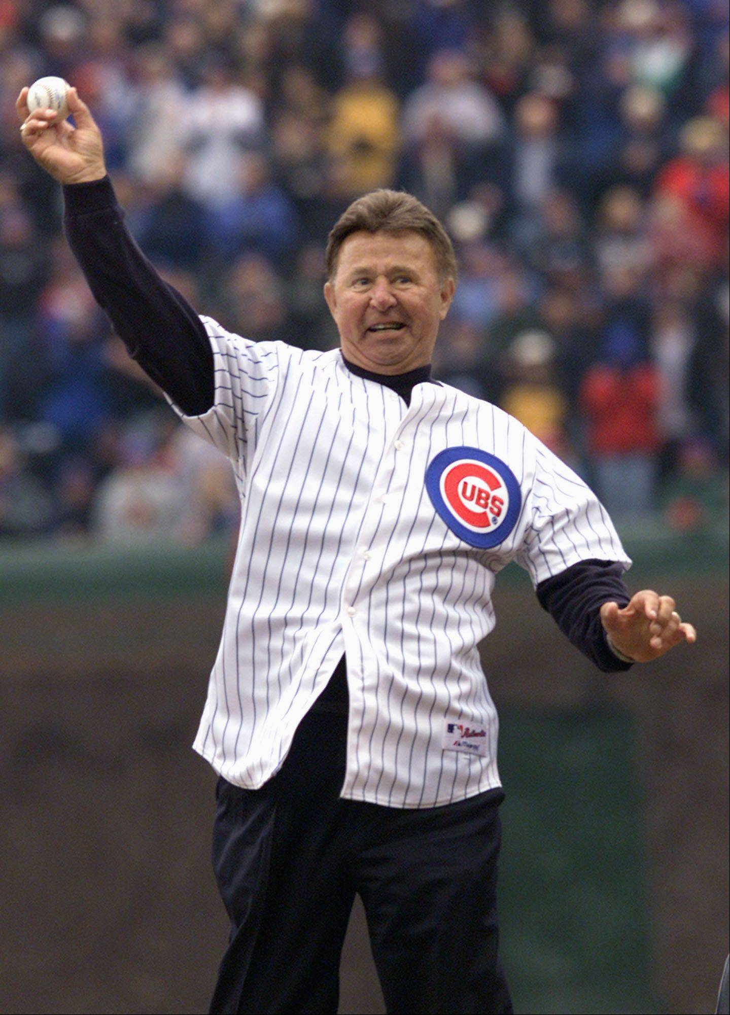 This April 5, 2002, file photo shows former Cubs third baseman and now Hall of Famer Ron Santo throwing out the ceremonial first pitch before the home opener at Wrigley Field.