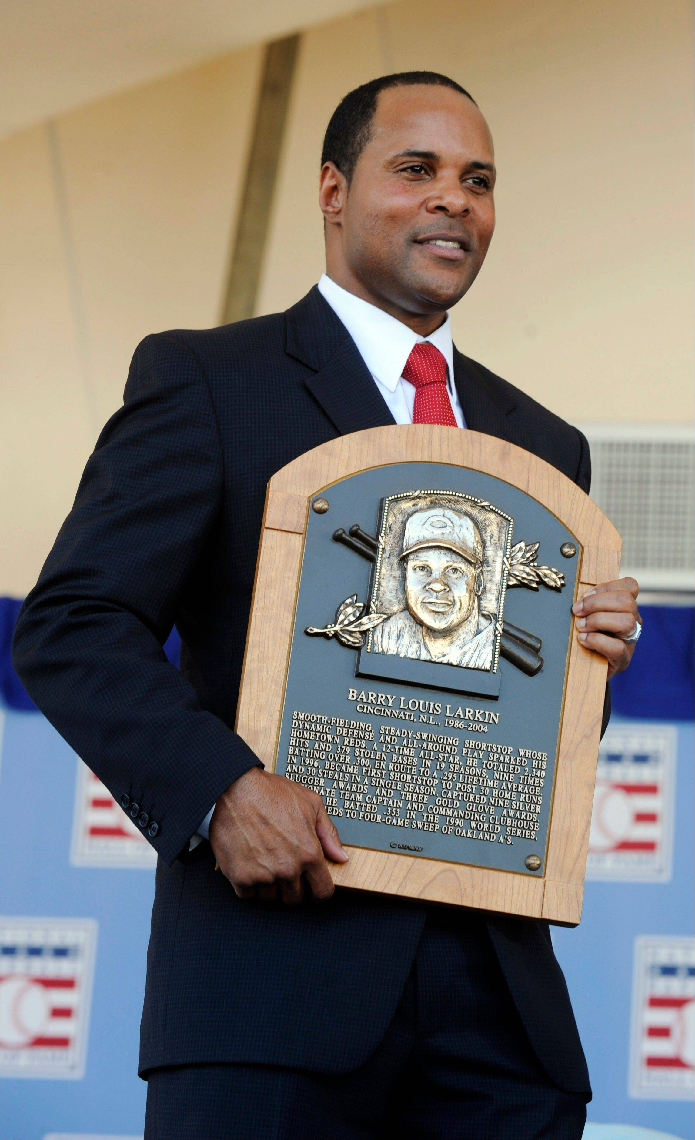 Former Cincinnati Reds star Barry Larkin holds his plaque after Sunday�s induction into the National Baseball Hall of Fame and Museum in Cooperstown, N.Y.