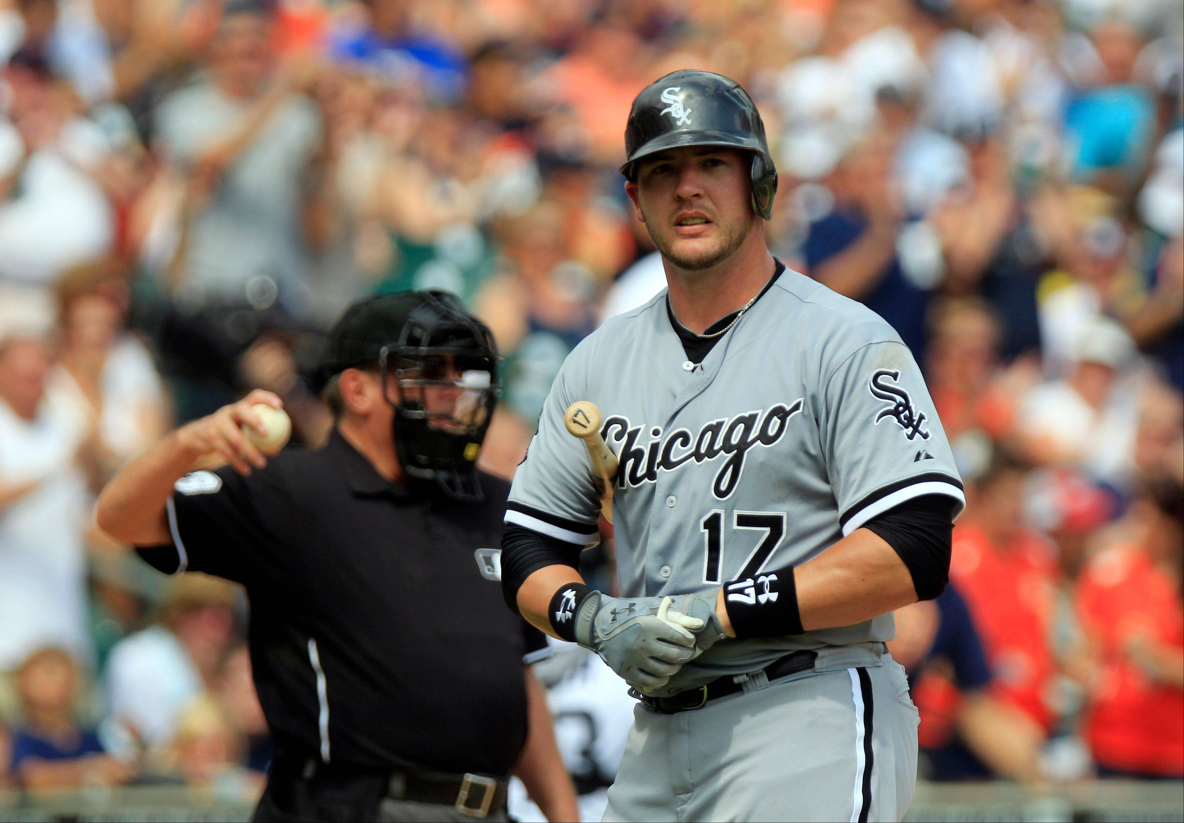 White Sox catcher Tyler Flowers walks back to the dugout after striking out during the ninth inning of Sunday�s 6-4 loss at Detroit.