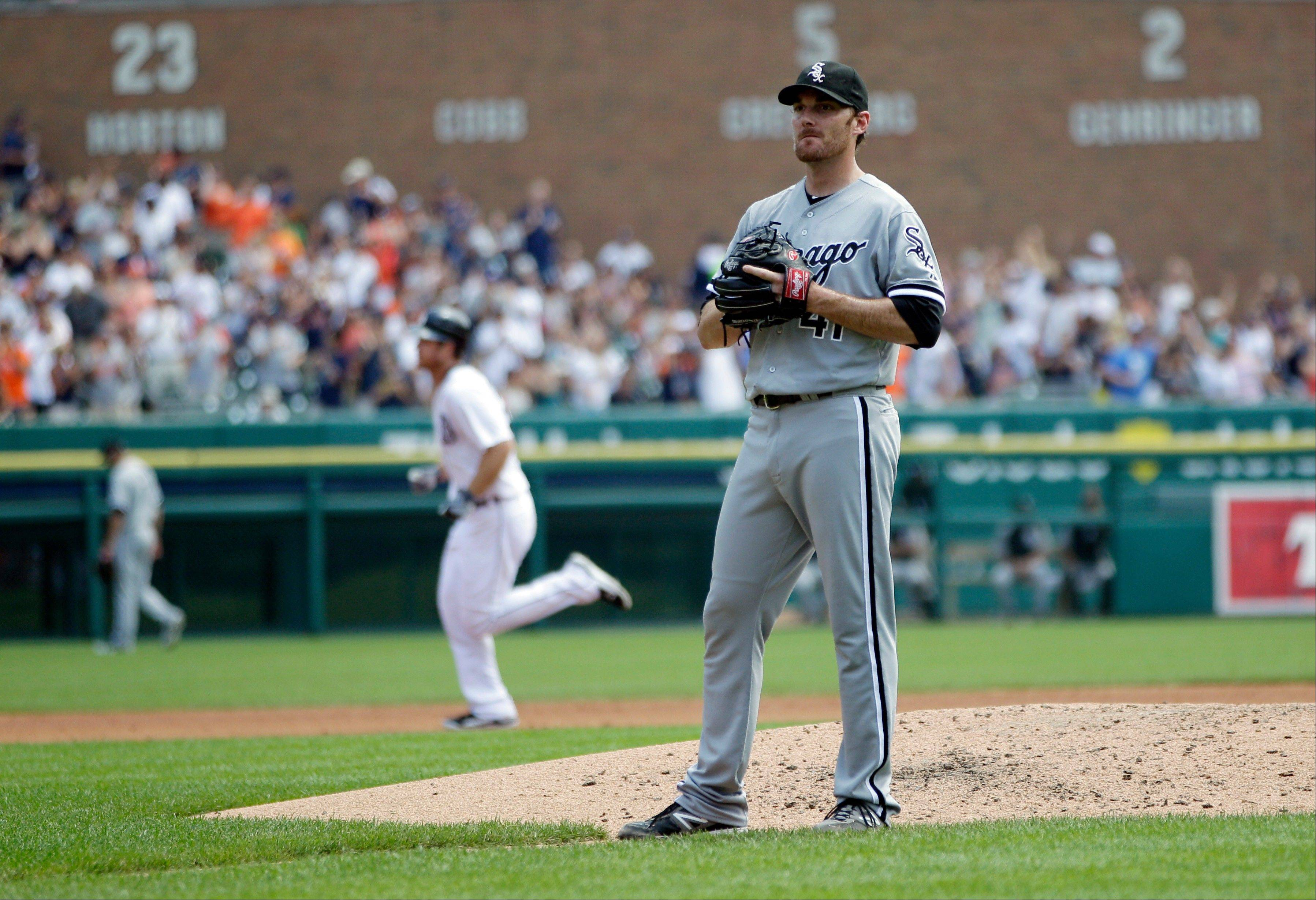 White Sox starting pitcher Philip Humber, right, stands at the mound Sunday as the Detroit Tigers� Brennan Boesch rounds the bases after hitting a two-run home run in the third inning.