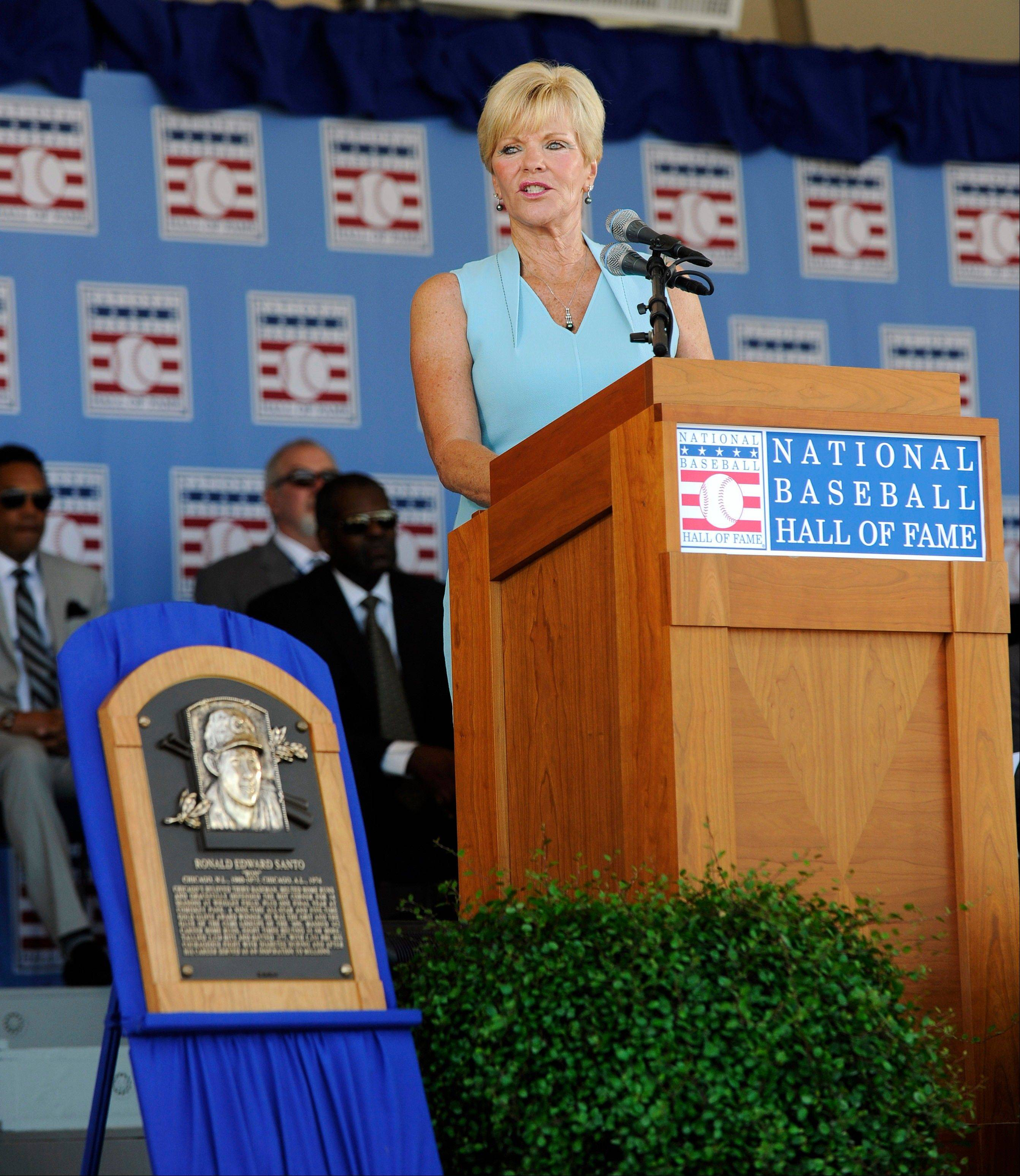 Vicki Santo, widow of star Cubs third baseman and team broadcaster Ron Santo, delivers a speech Sunday during his National Baseball Hall of Fame and Museum induction ceremony in Cooperstown, N.Y.