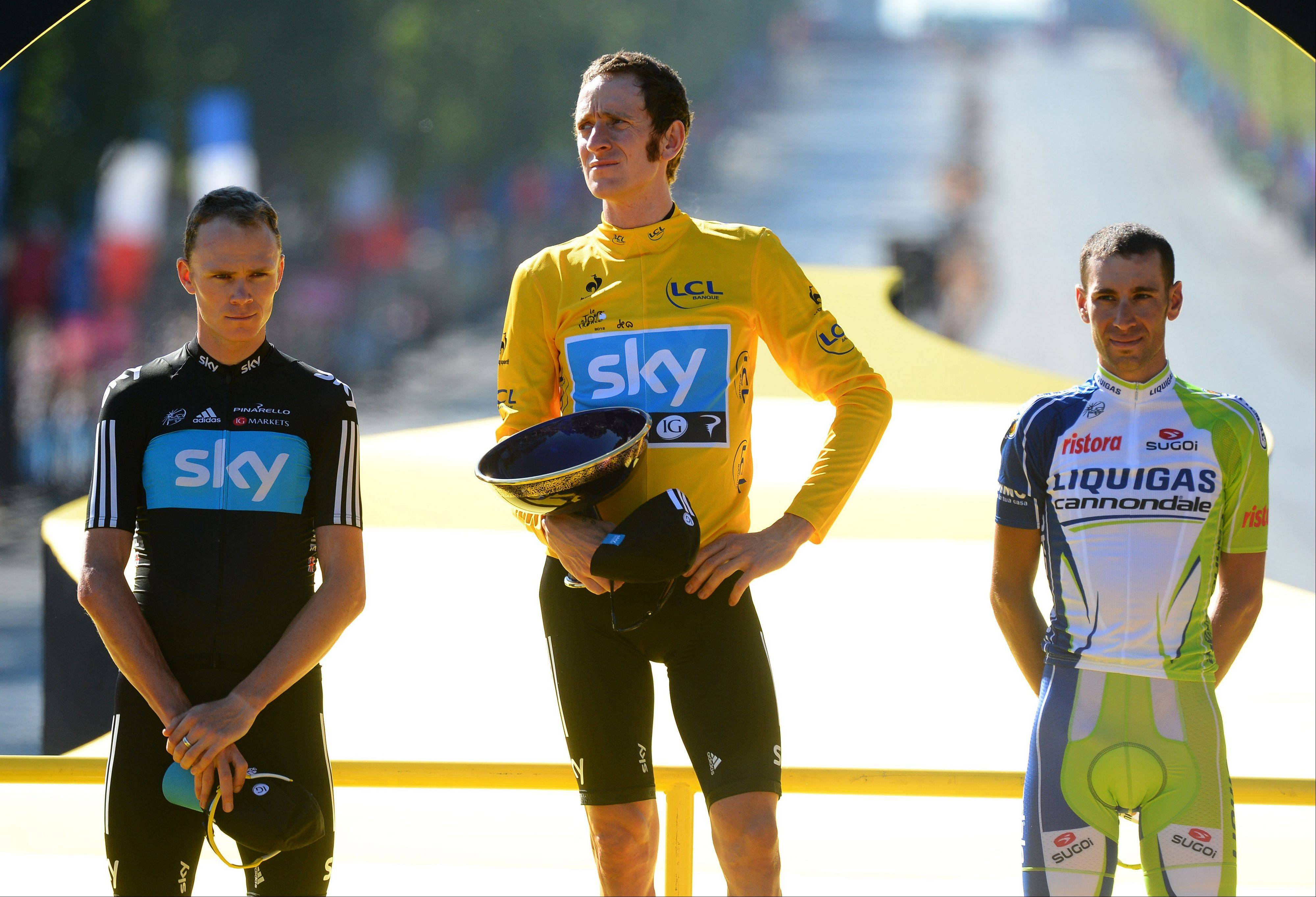 Second place Christopher Froome of Britain, left, Tour de France winner Bradley Wiggins of Britain, center, and third place Vincenzo Nibali of Italy, right, on the podium of the Tour de France.