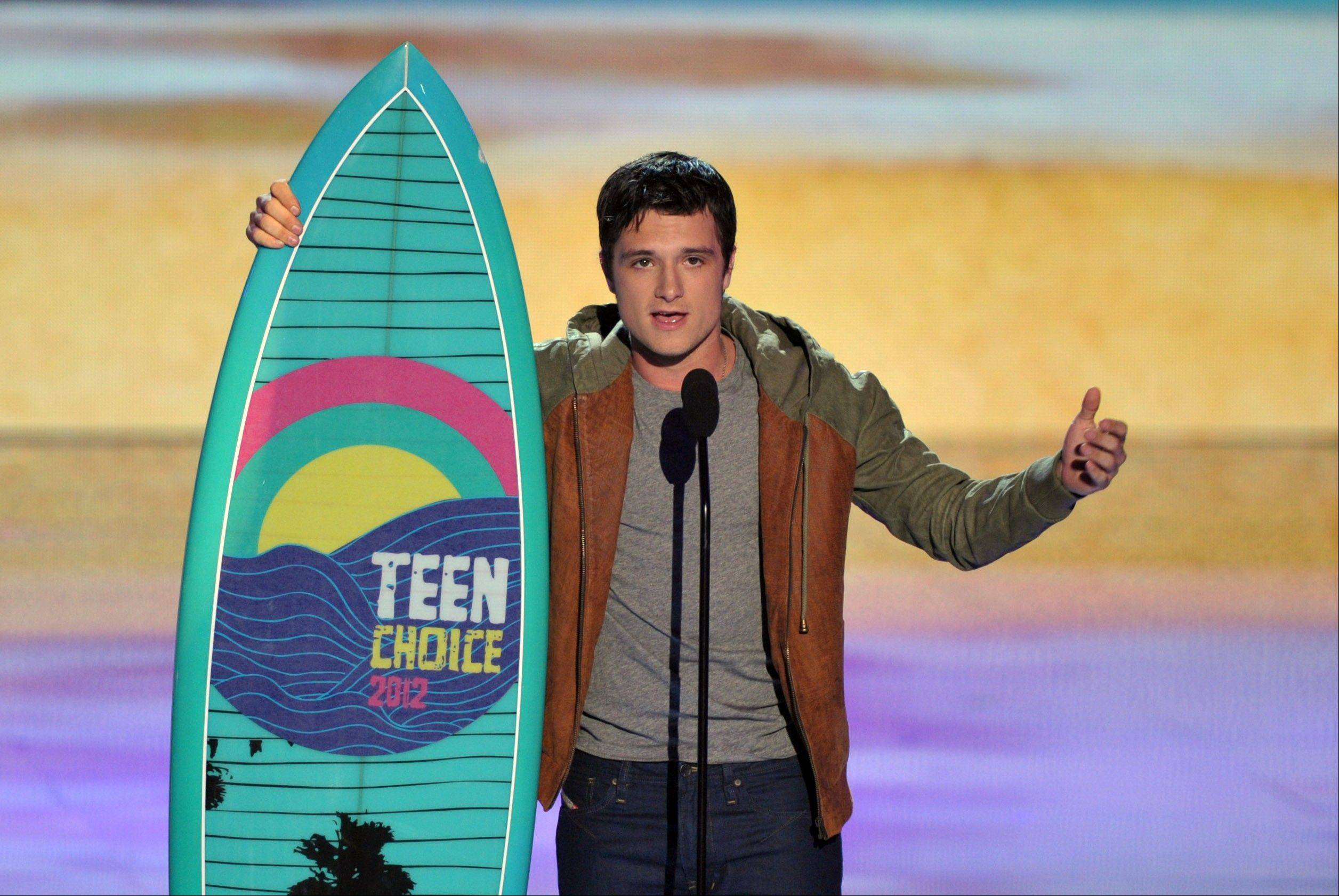 Josh Hutcherson accepts the award for choice movie actor: sci-fi/fantasy at the Teen Choice Awards on Sunday.