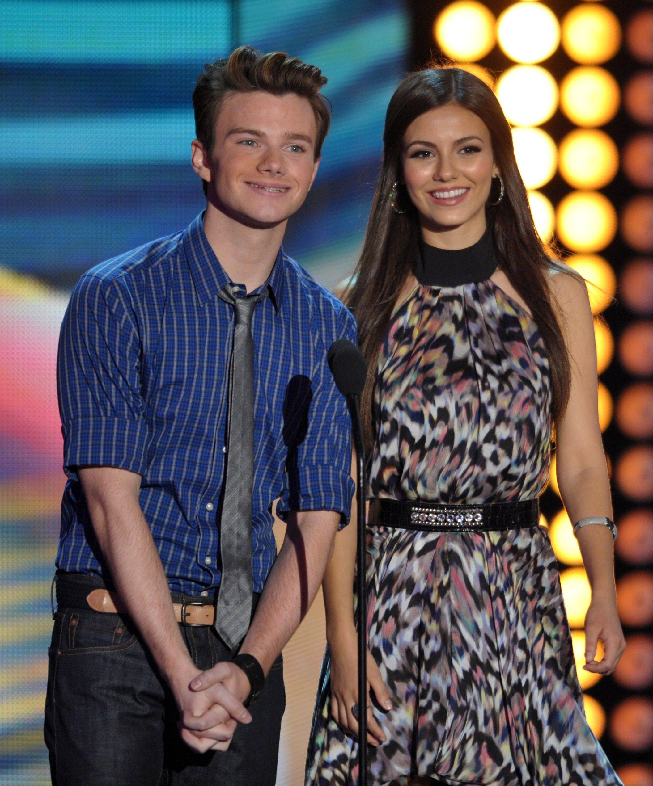Chris Colfer and Victoria Justice speak onstage at the Teen Choice Awards on Sunday.