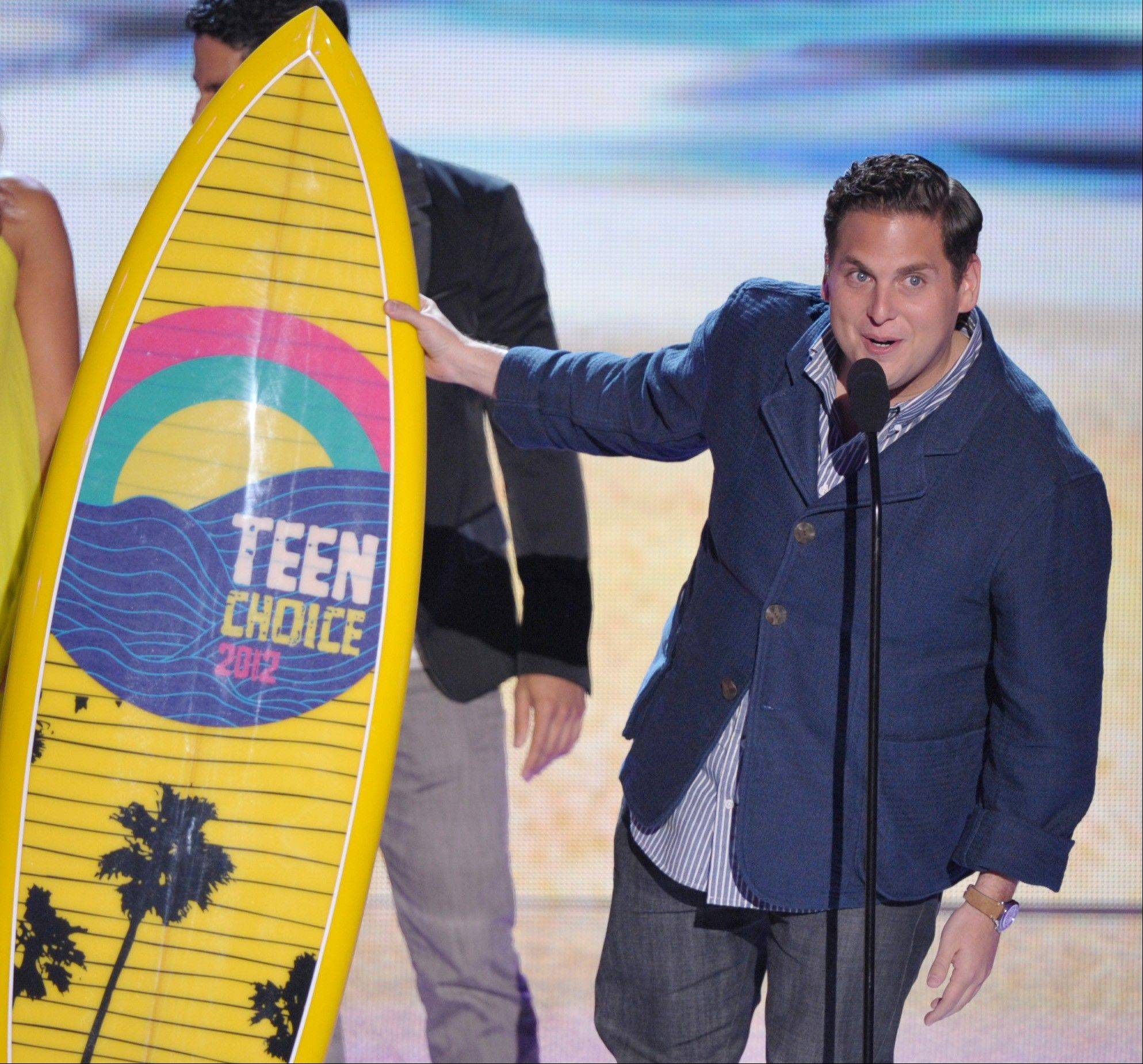Jonah Hill accepts the award for choice comedy movie award onstage at the Teen Choice Awards on Sunday.