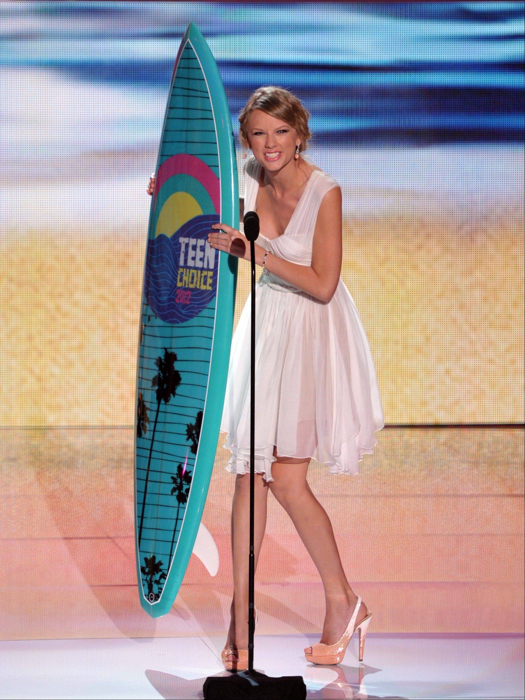 Taylor Swift accepts the award for best female artist at the Teen Choice Awards on Sunday in Universal City, Calif.